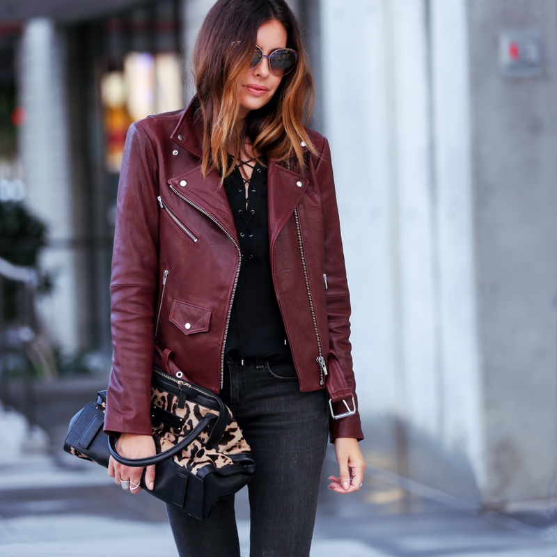 burgundy leather jacket with lace up top and leopard print bag