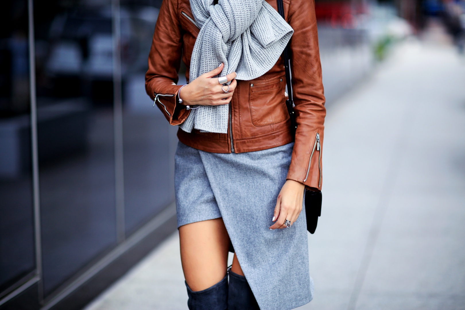 chunky knit scarf and leather jacket