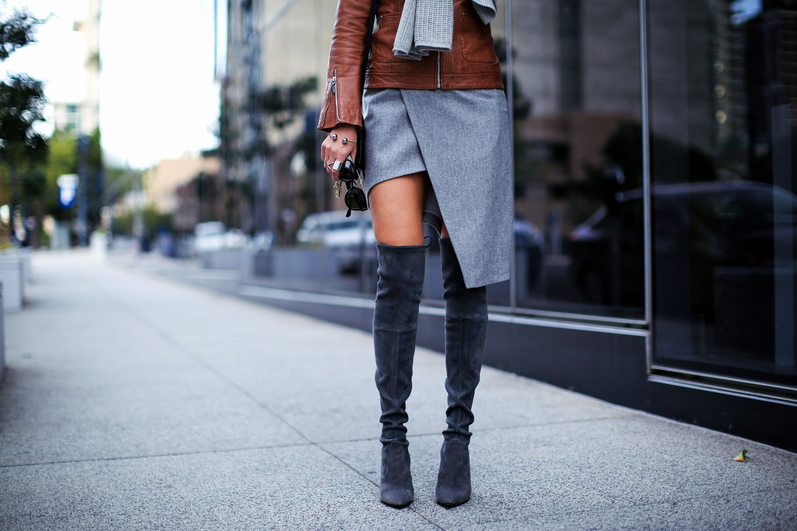 over the knee boots and skirt