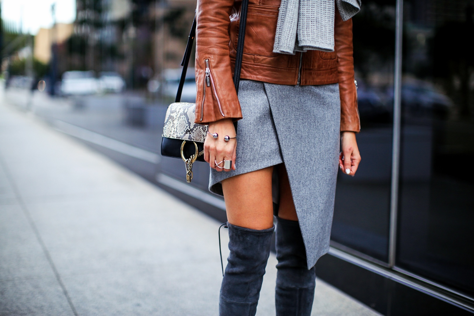 asymmetrical skirt , over the knee boots, and chloe faye