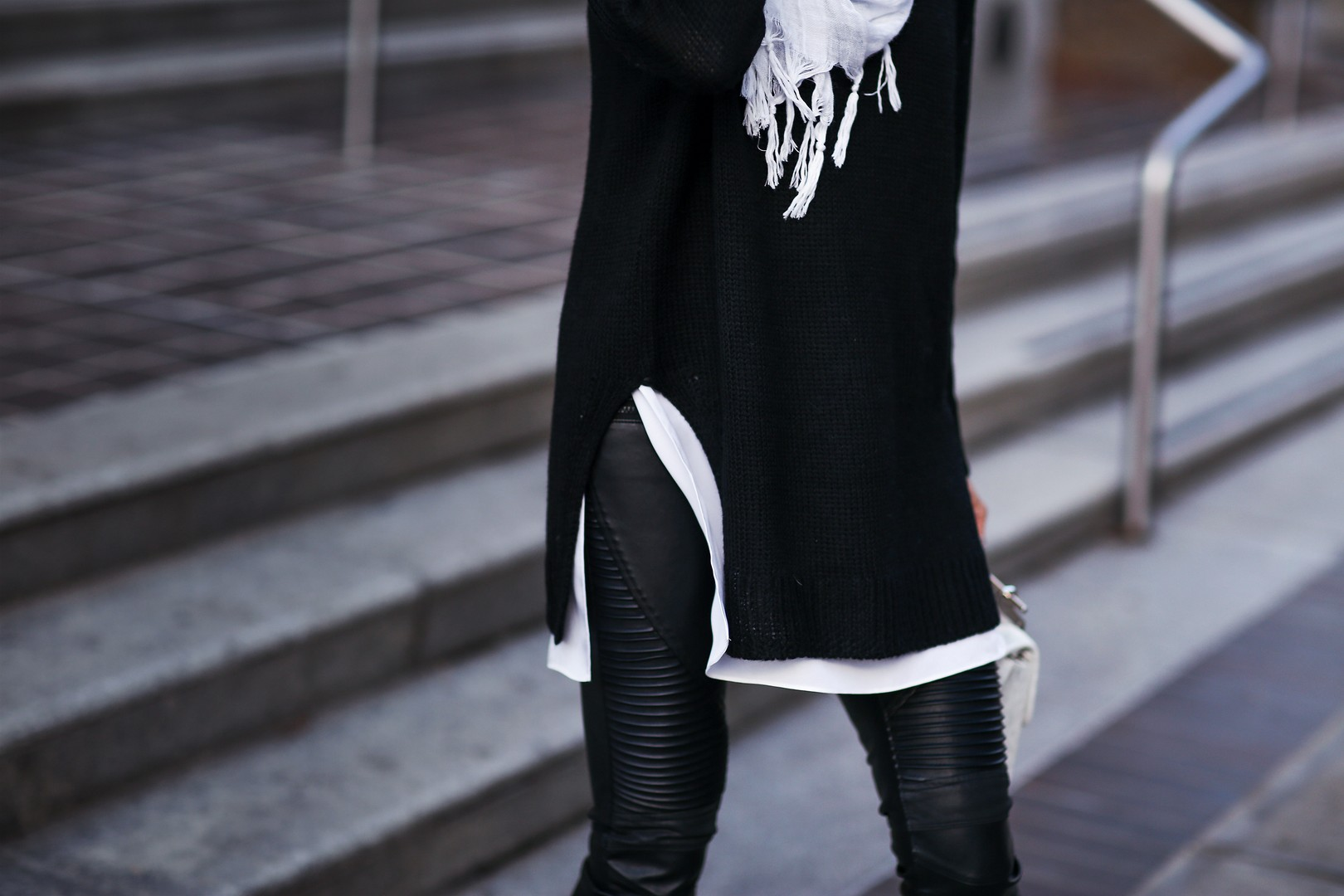 layering side slit sweater and moto leather pants
