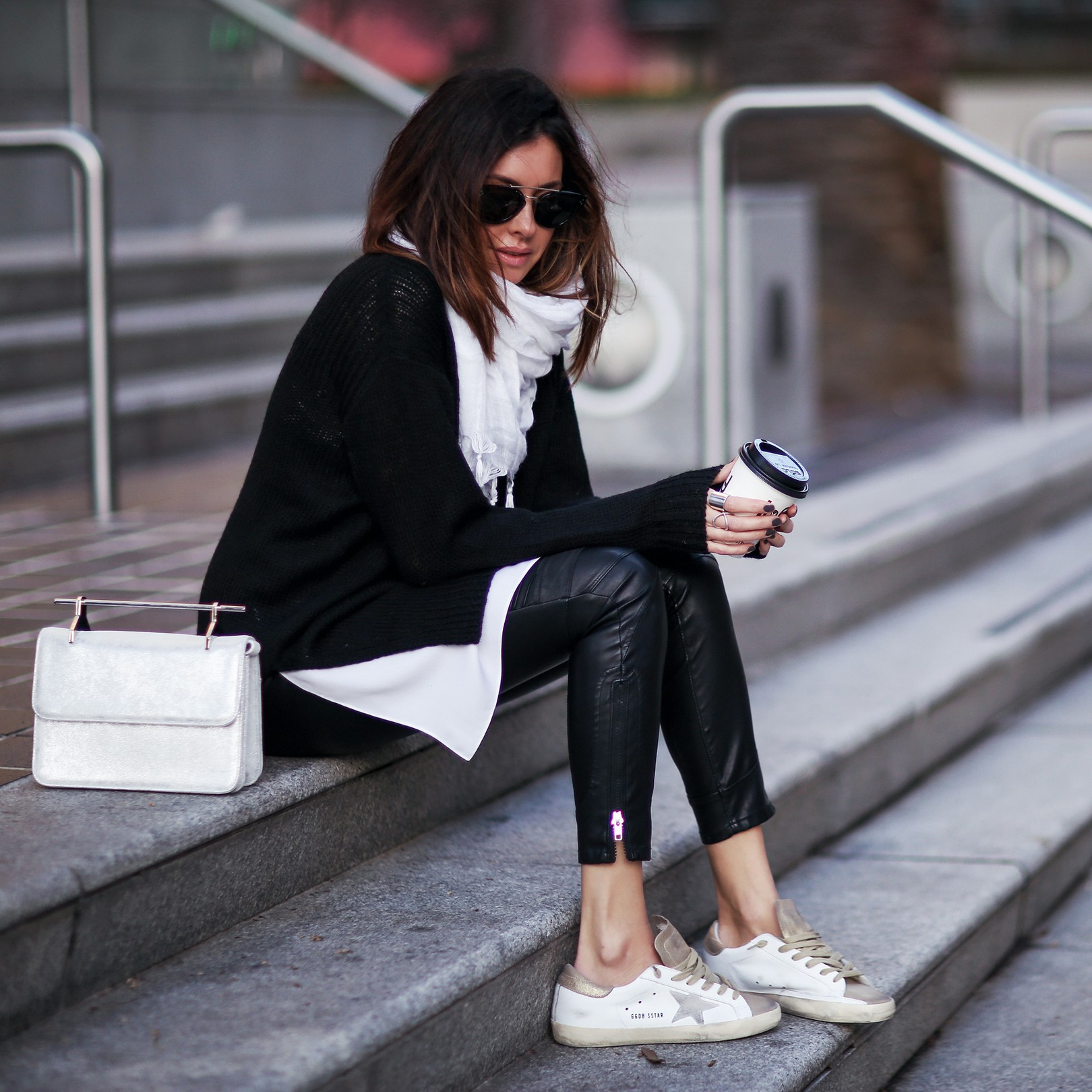 leather pants and sneaker outfit