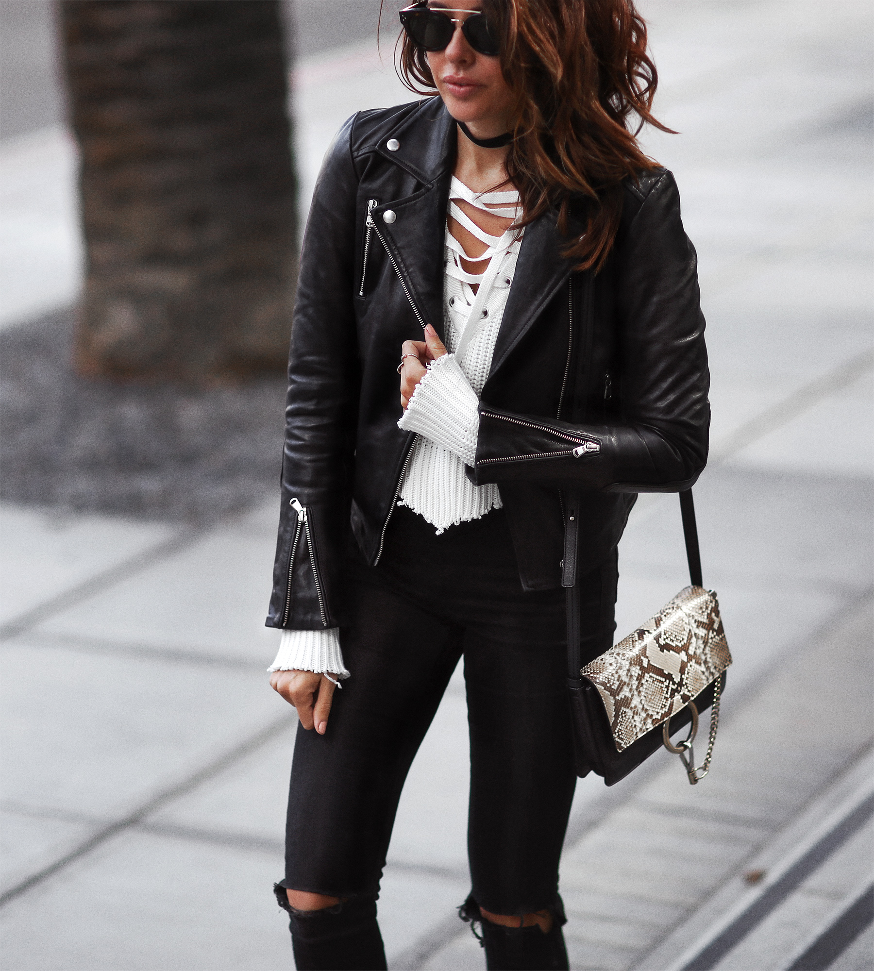 leather jacket and lace up sweater