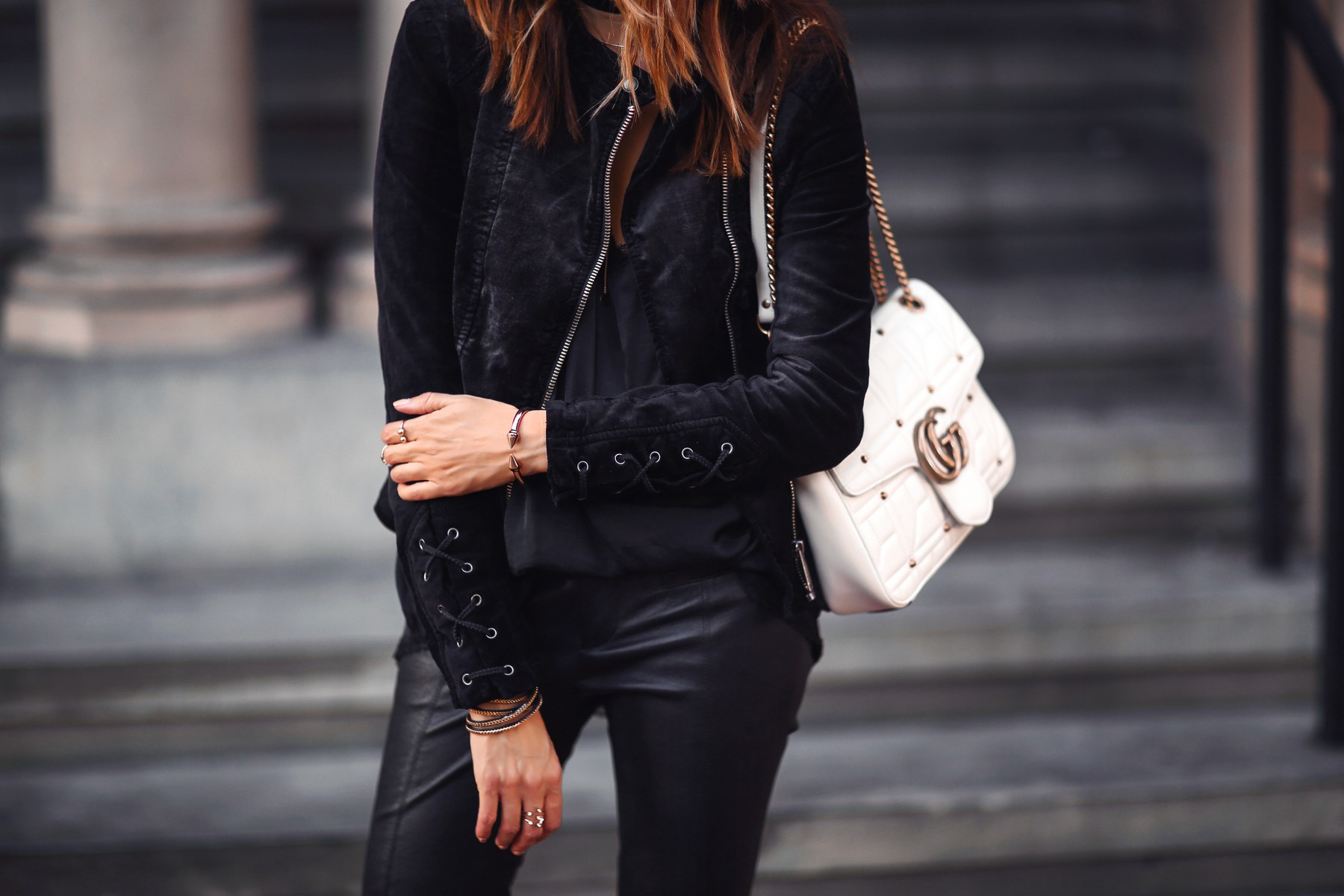 black velvet jacket, gucci bag, and leather pants
