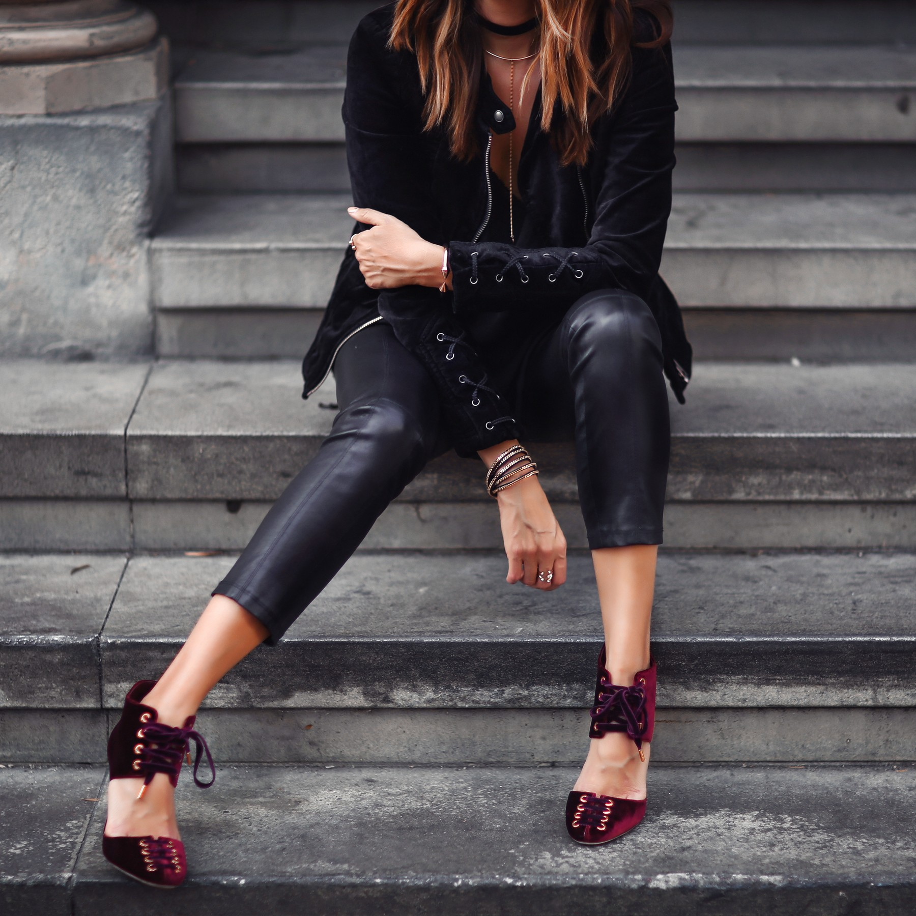 black velvet jacket, leather pants, and red velvet heels