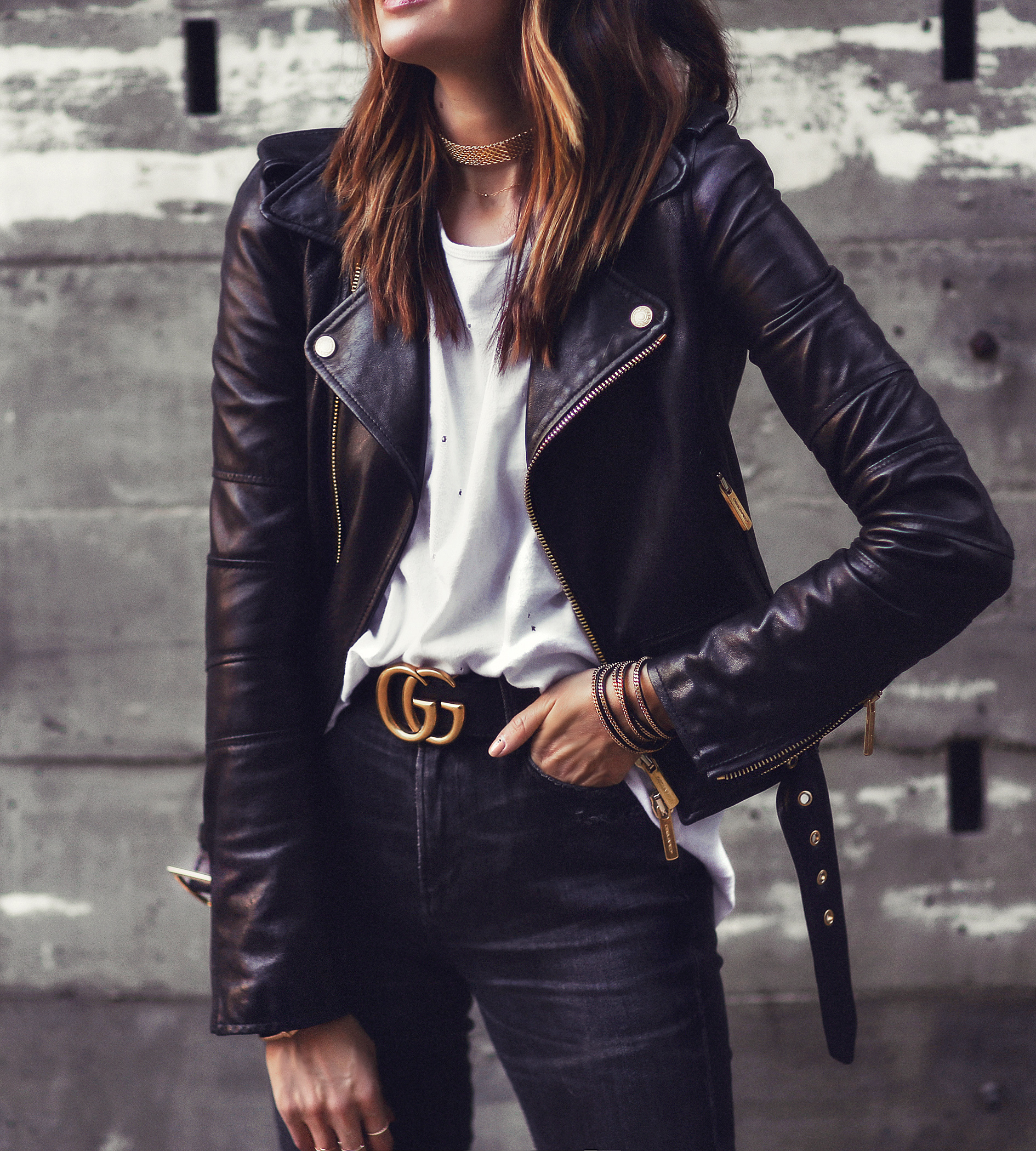 black and gold gucci belt and leather jacket