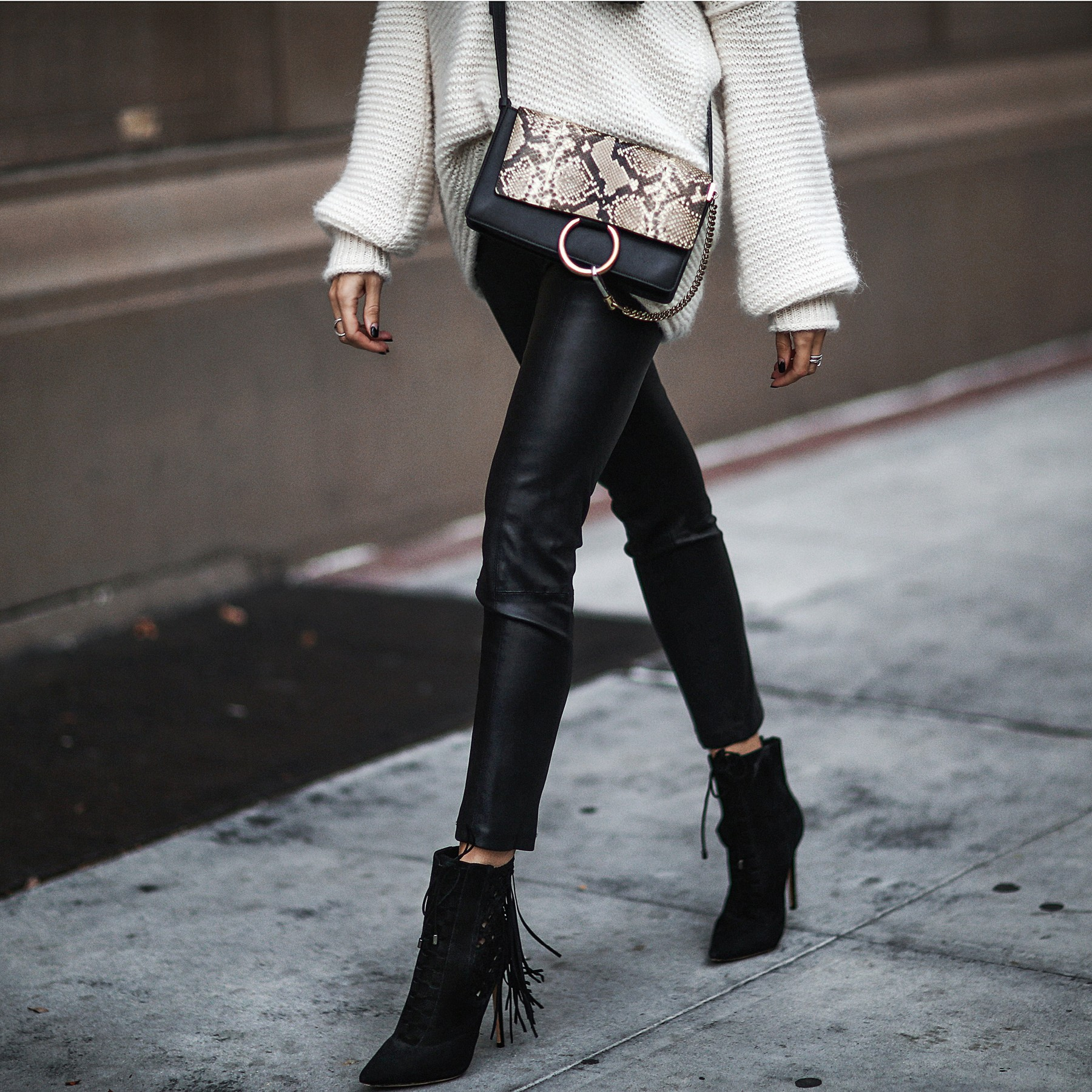 oversized knit sweater, leather pants, chloe bag, fringe booties