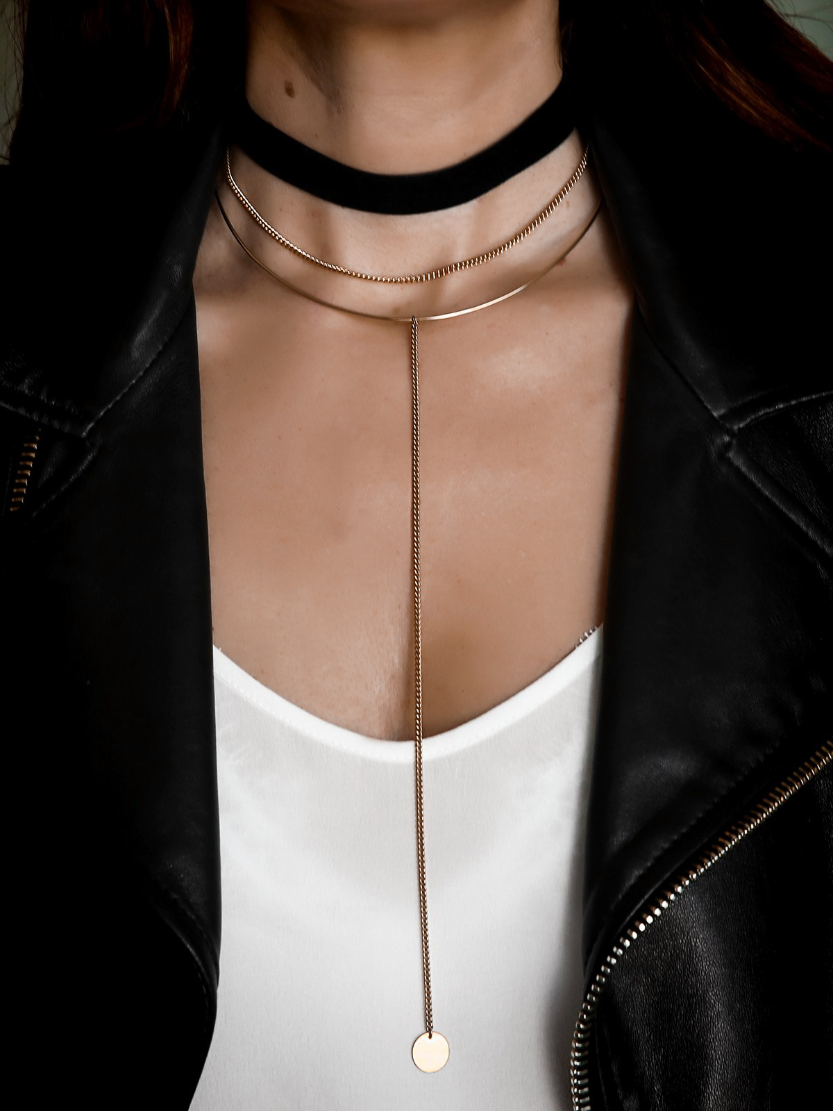layered necklaces and velvet choker