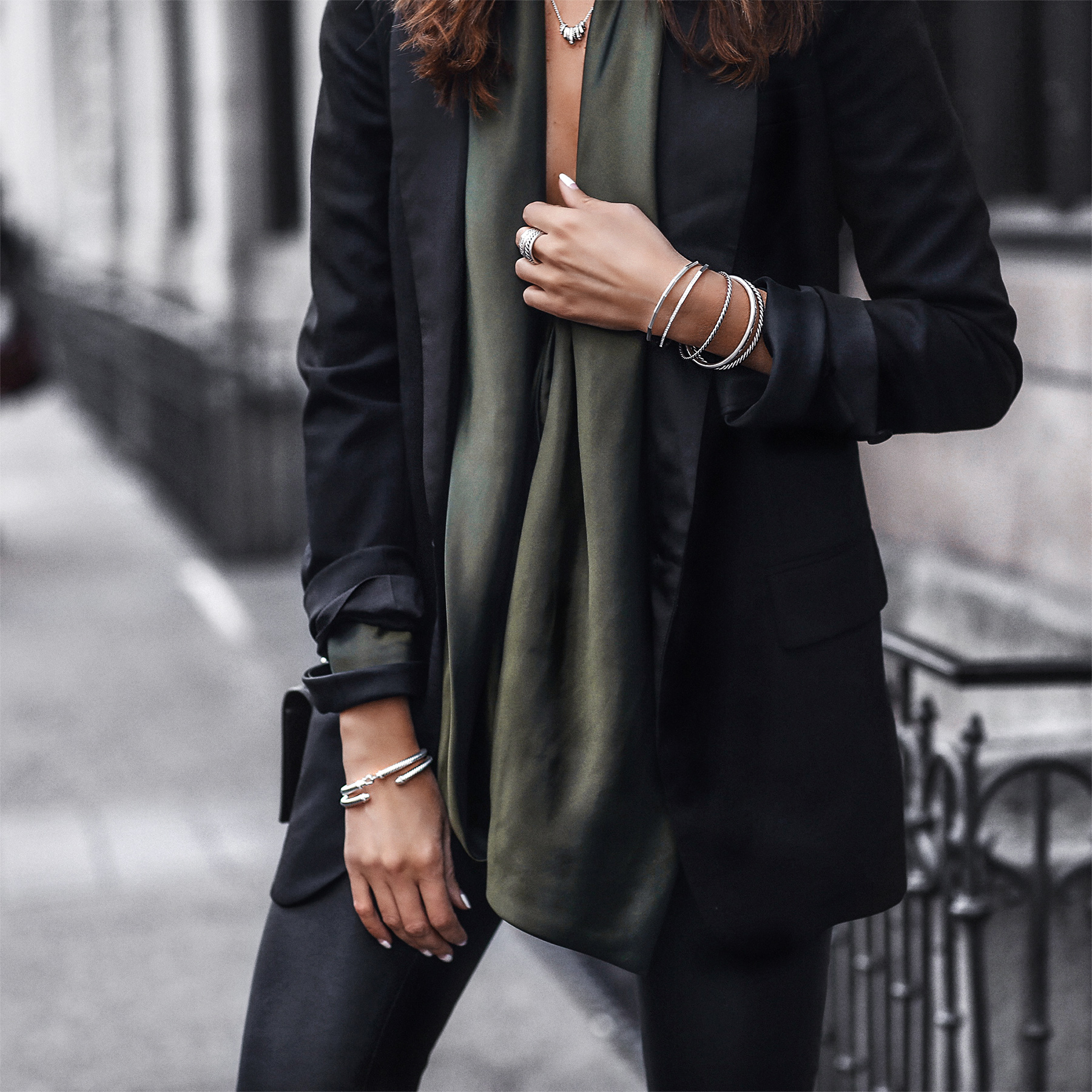 black blazer, satin green top, stacked silver jewelry