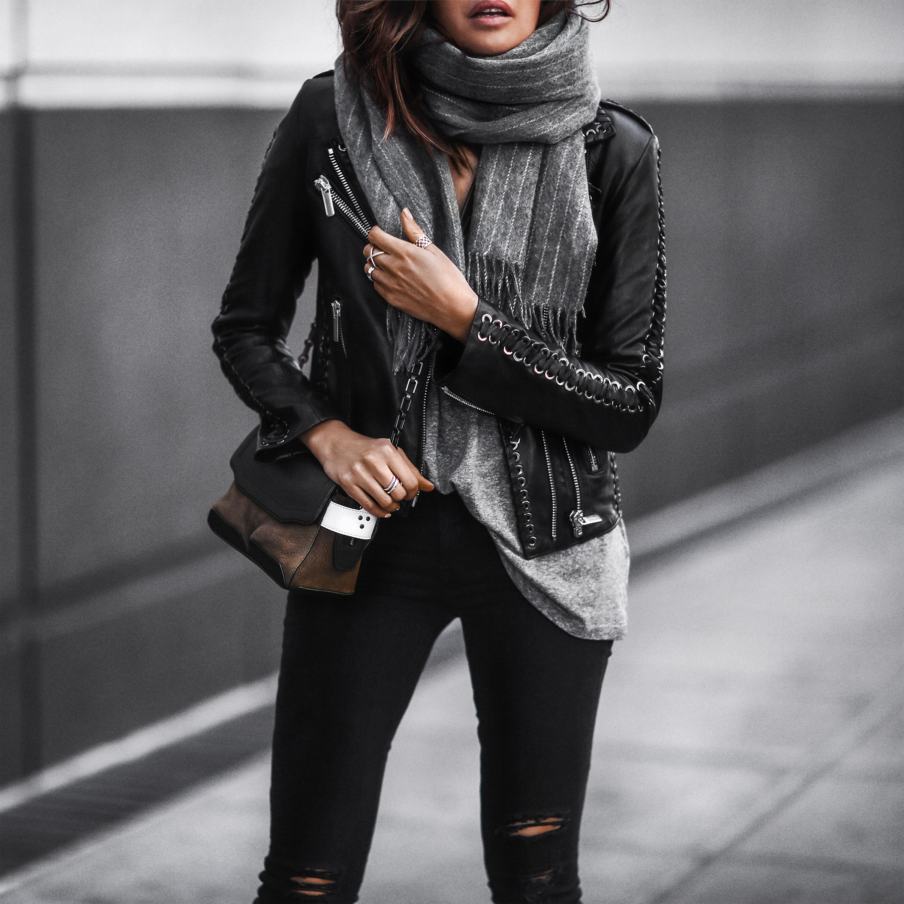 black leather jacket, pinstripe scarf, skinny jeans, satchel