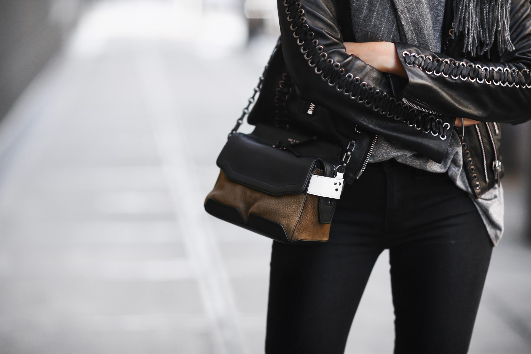 black leather jacket and satchel
