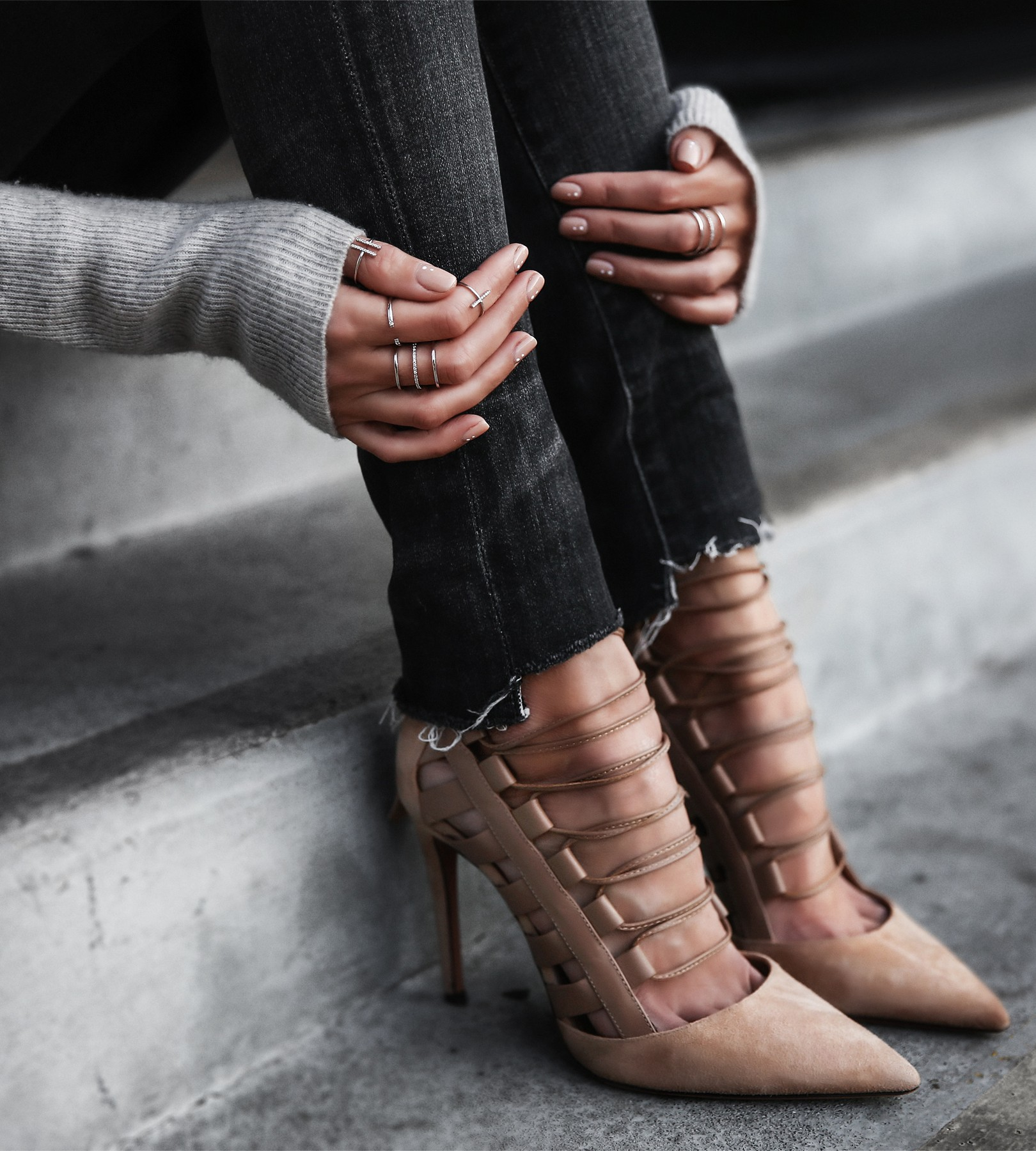 stacked rings and suede nude lace up heels