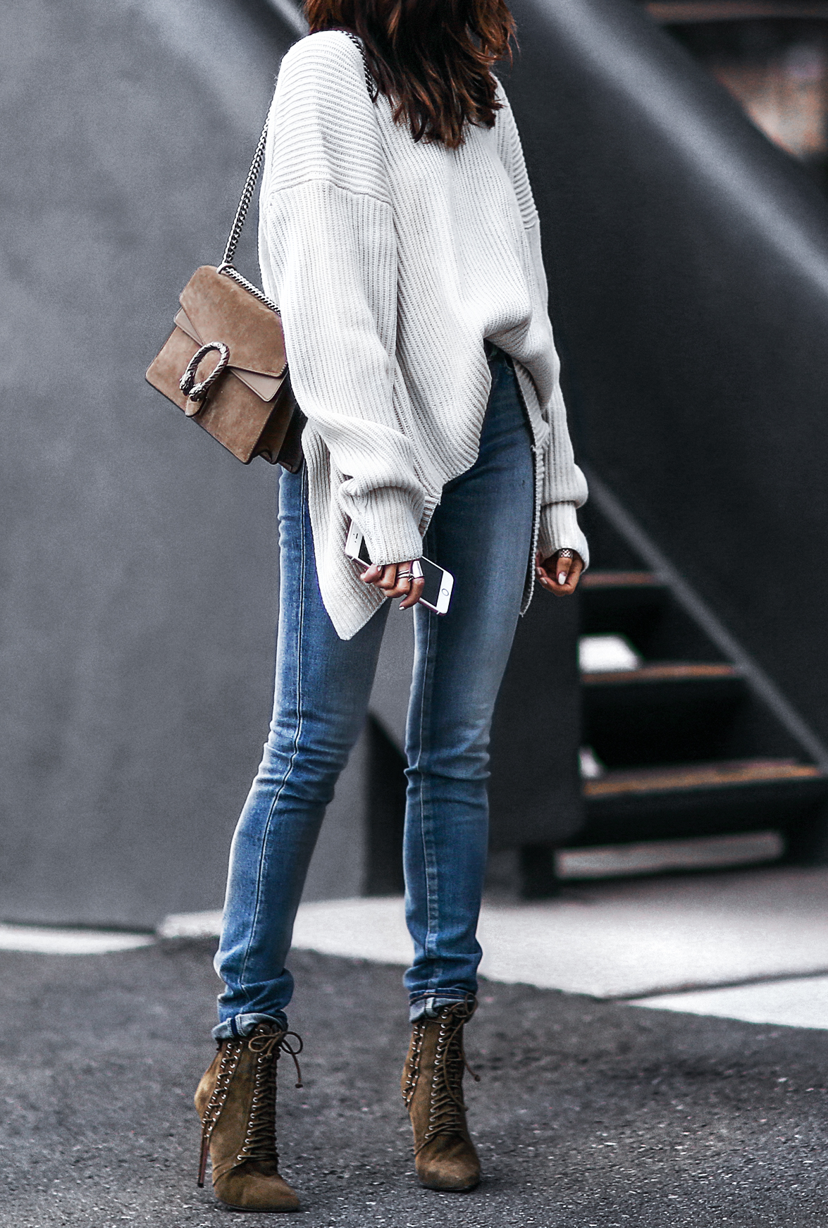 slouchy oversized sweater, skinny jeans, and lace up booties