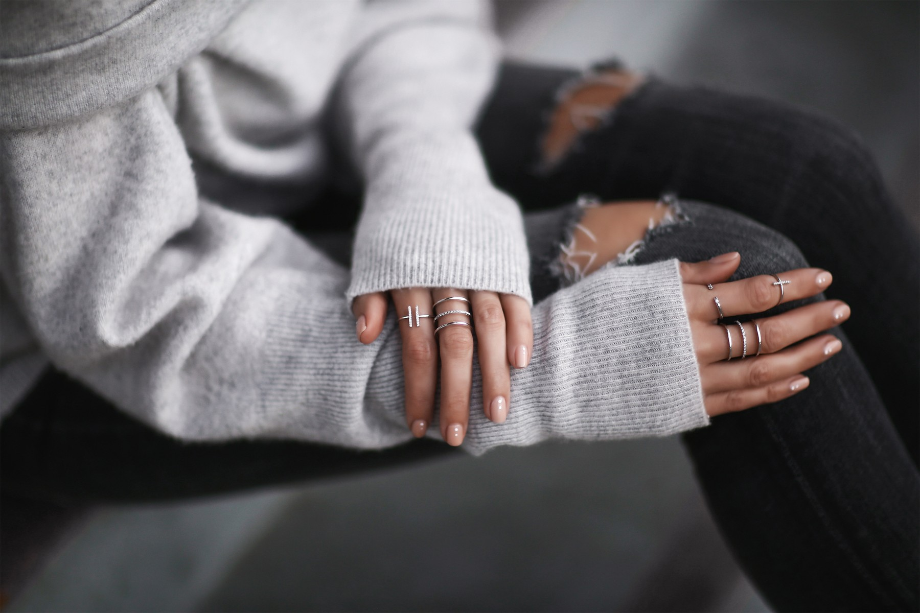 stacked rings and cozy sweater