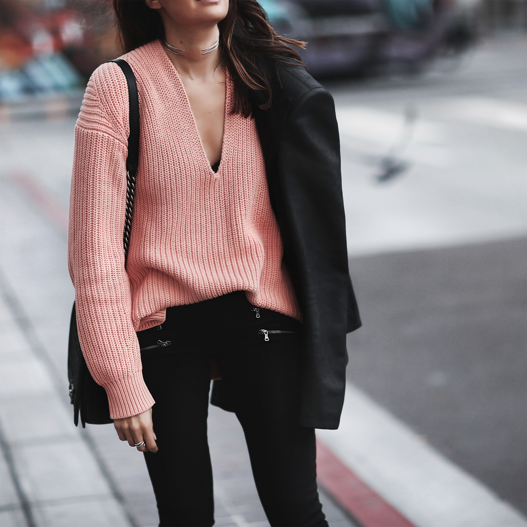coral sweater, skinny jeans with zippers, black blazer