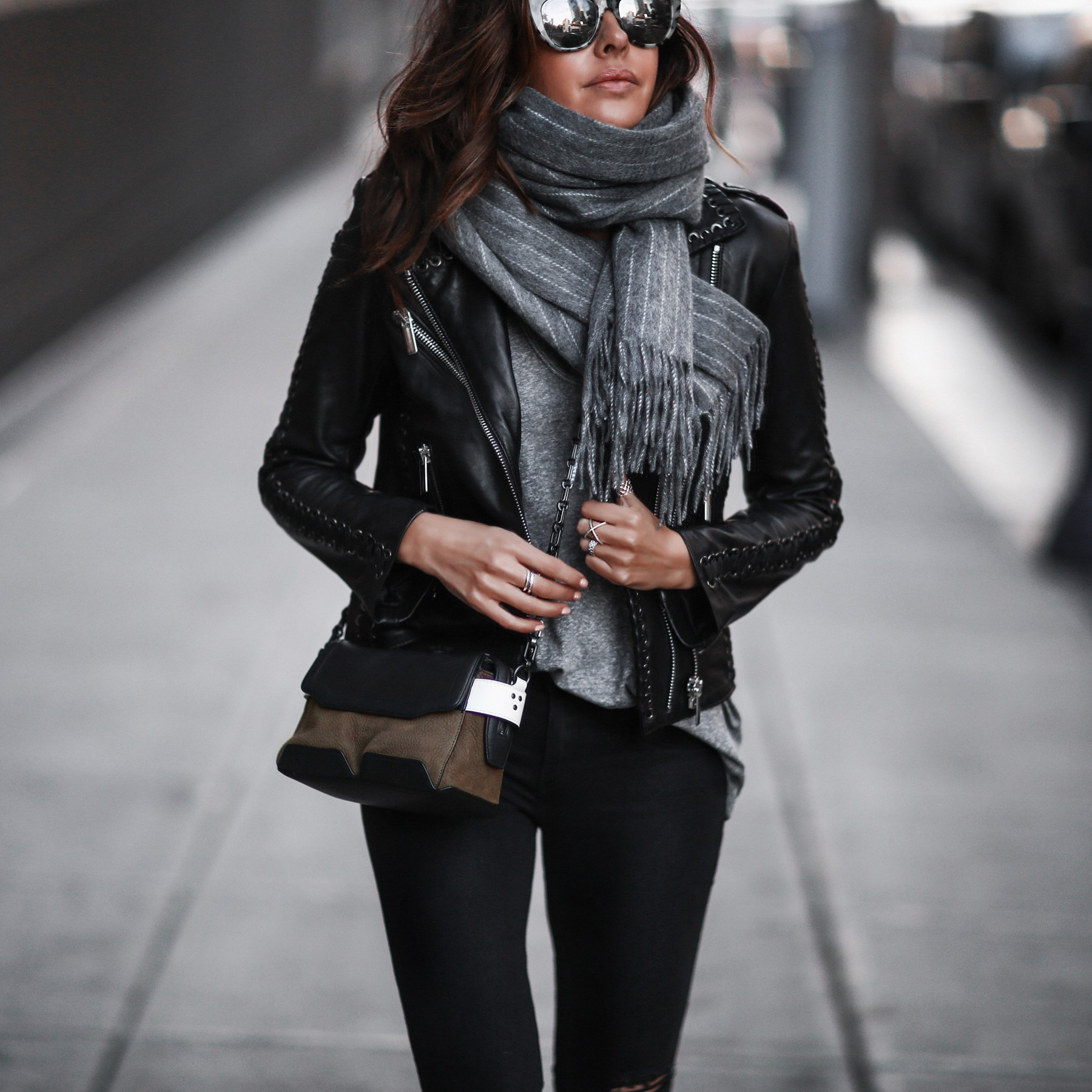 black leather jacket, pinstripe scarf, skinny jeans