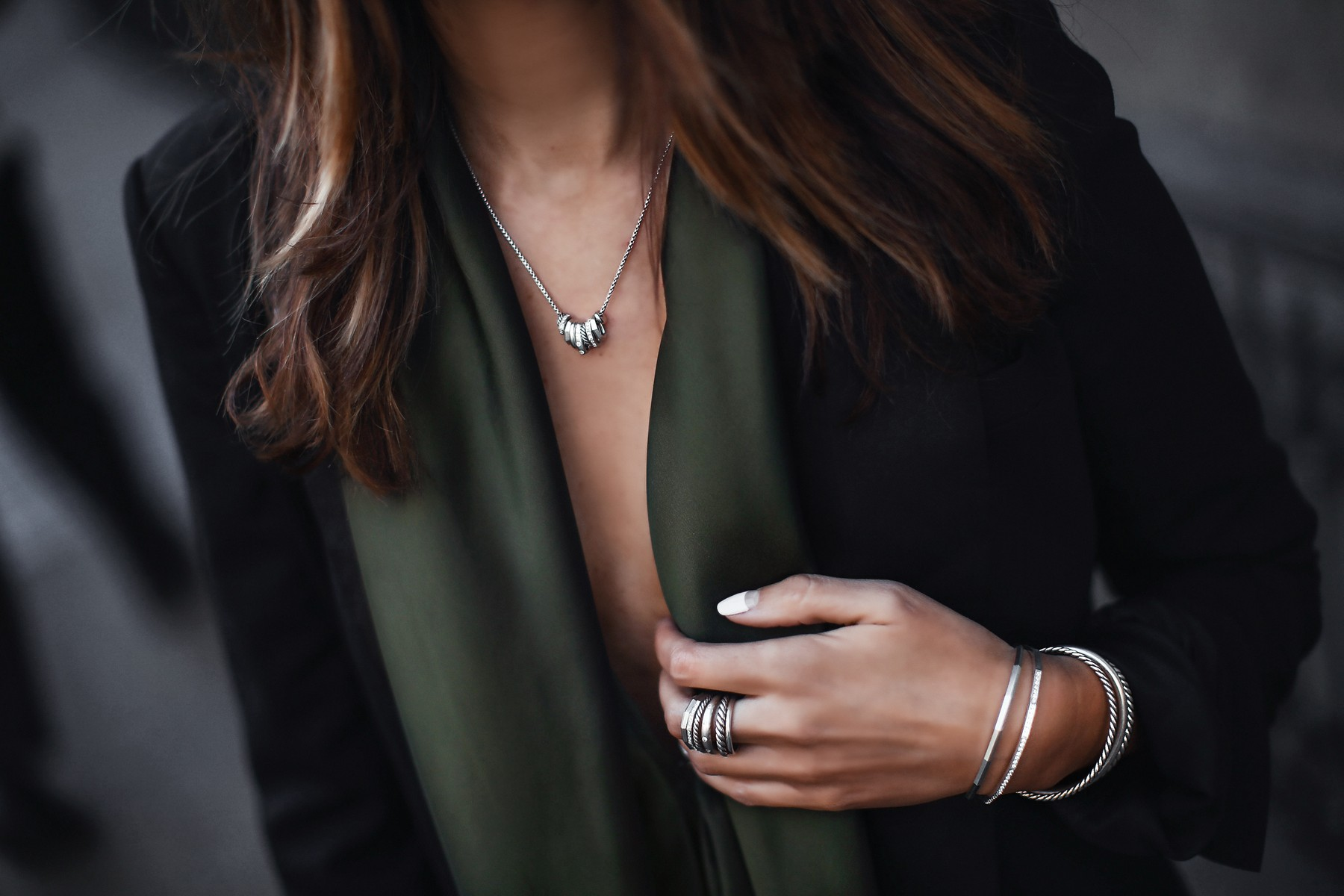 stacked silver rings, bracelets, and necklace