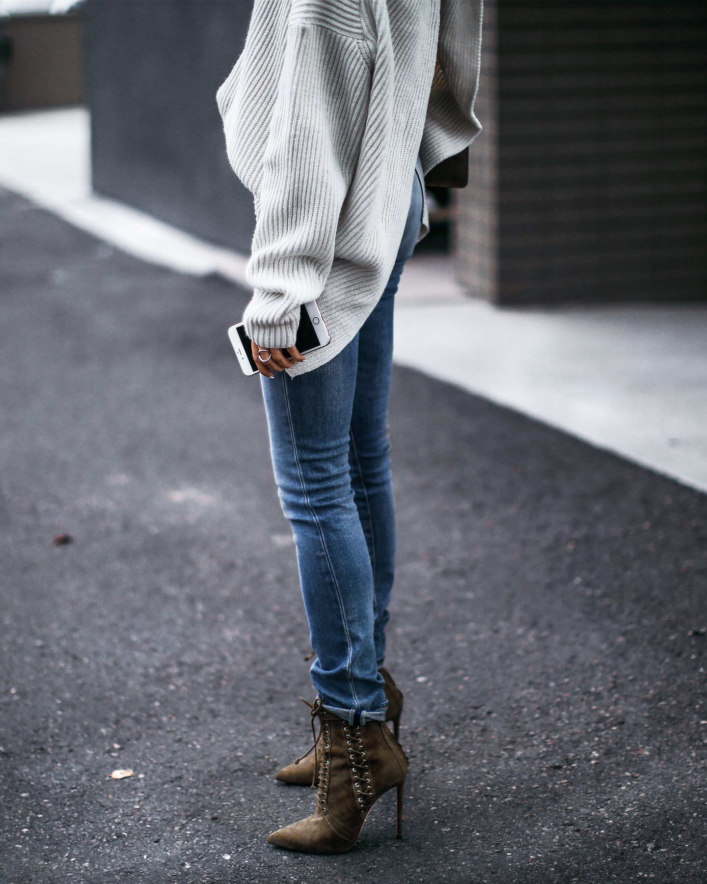slouchy oversized sweater with twisted back, skinny jeans, lace up booties