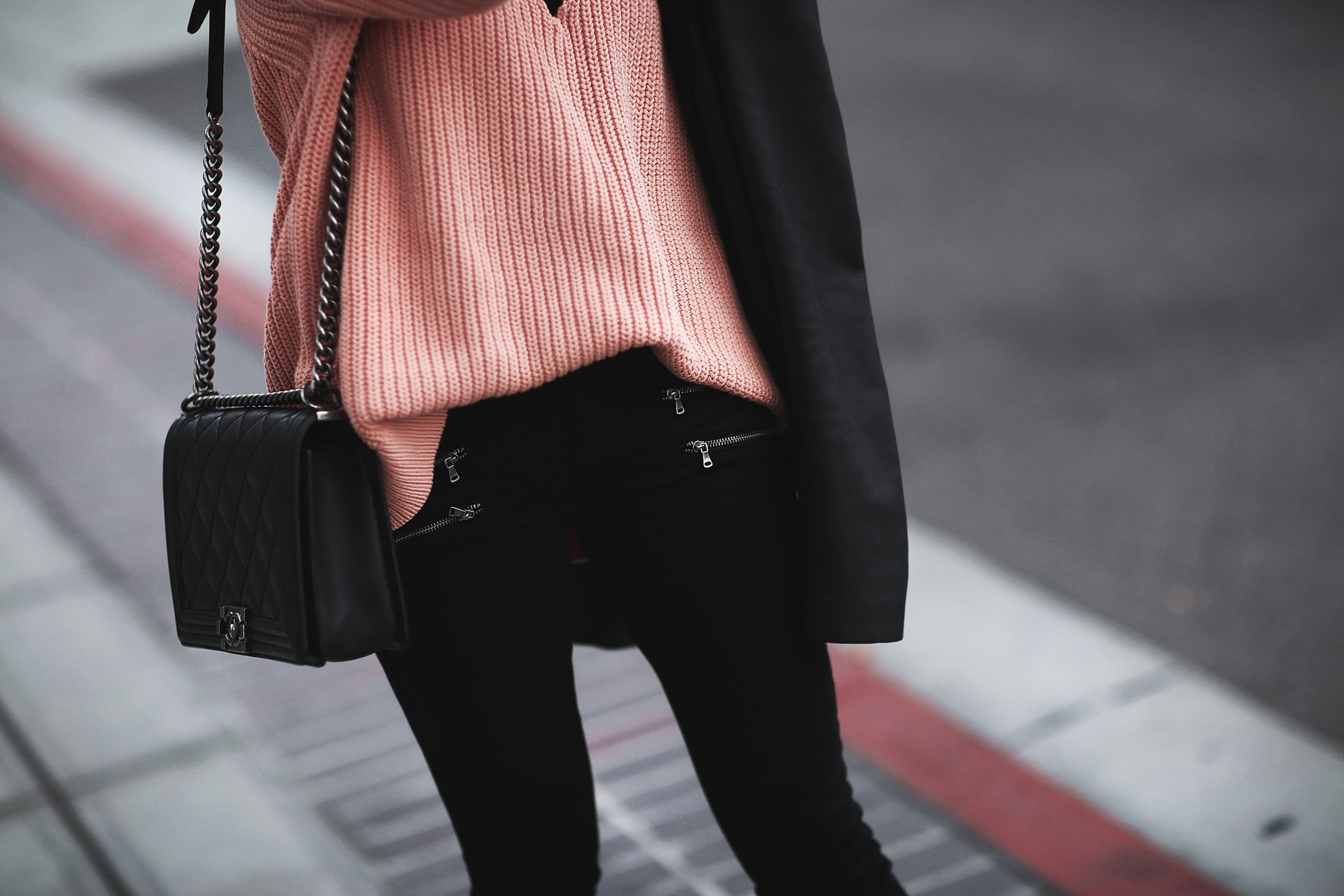 coral sweater, skinny jeans with zippers, black blazer, chanel bag