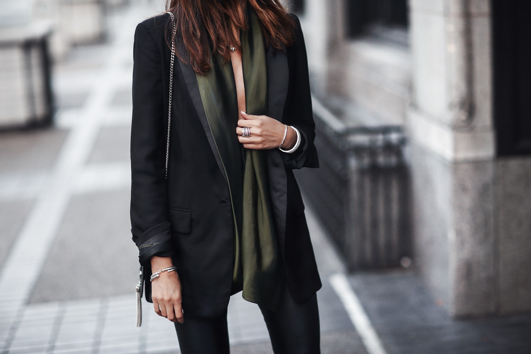 satin green top and blazer, silver jewelry