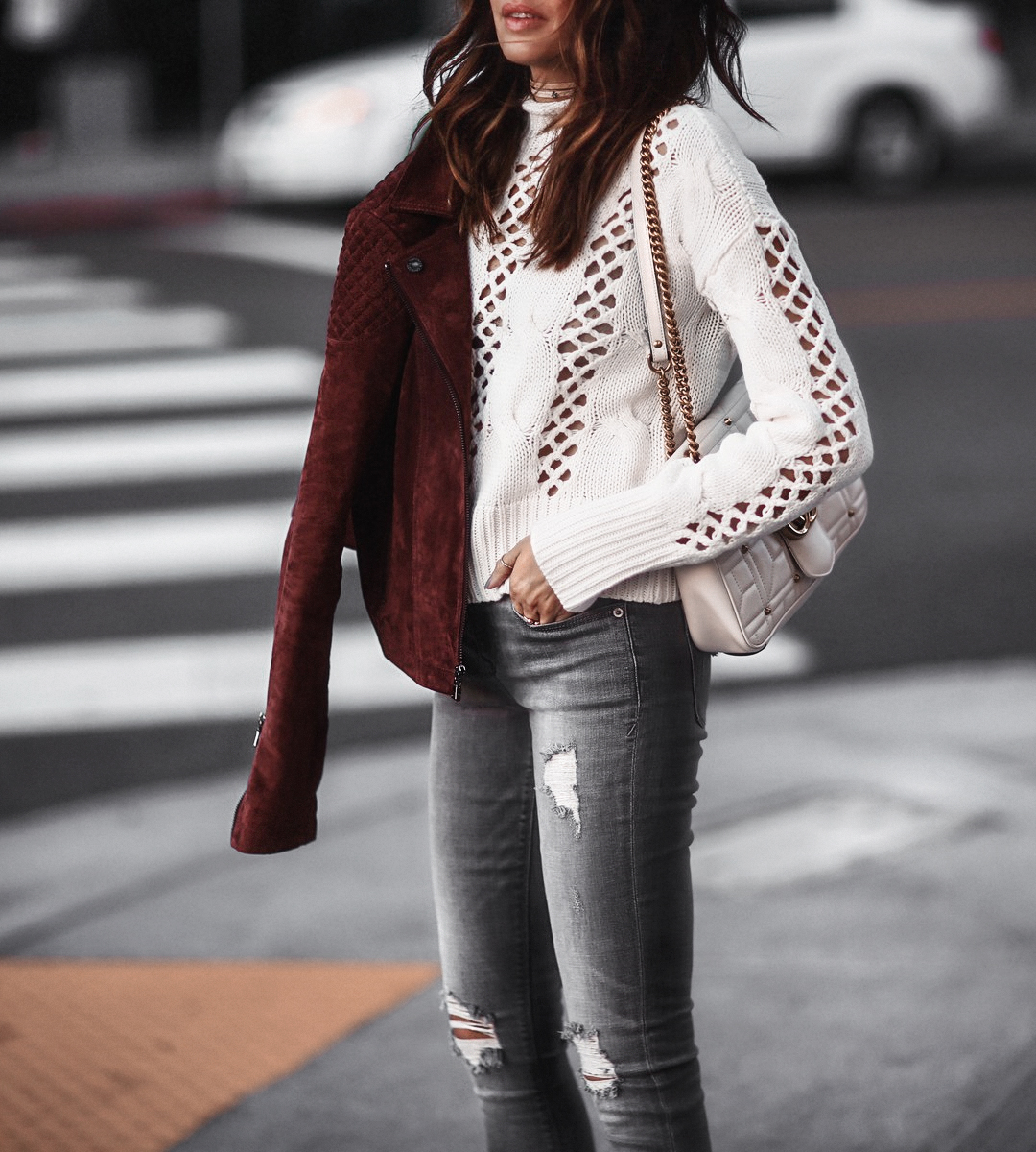 open knit sweater, suede jacket and ripped jeans