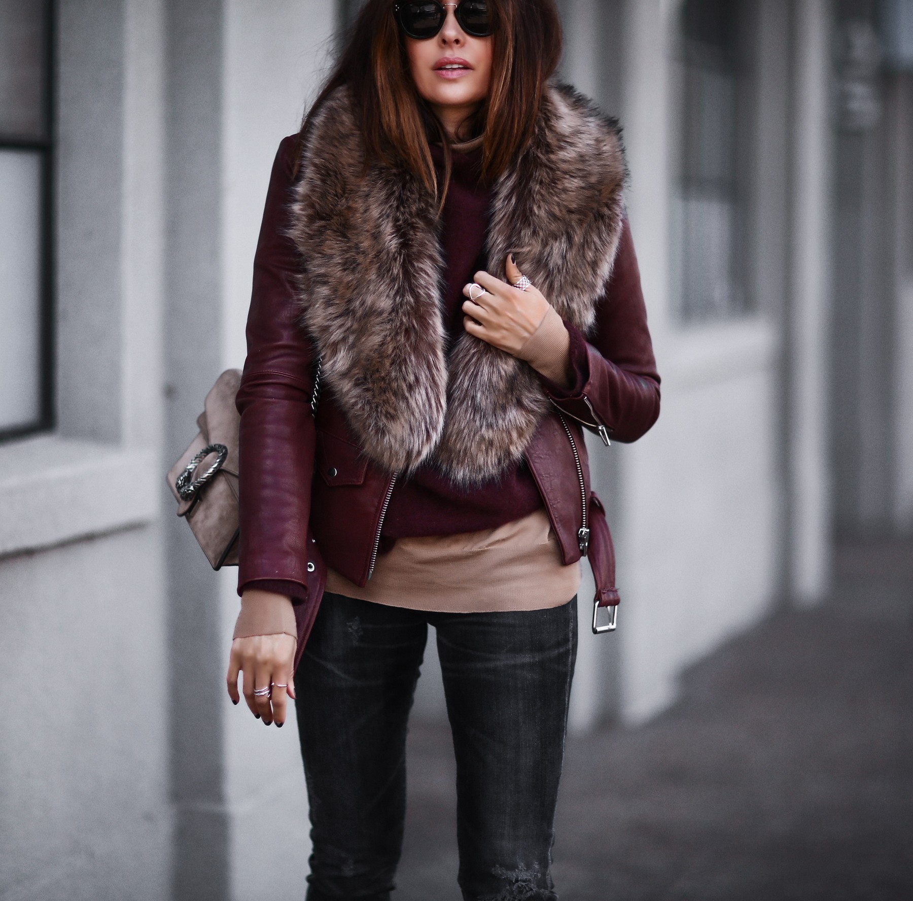 leather jacket, faux fur stole, layered sweaters