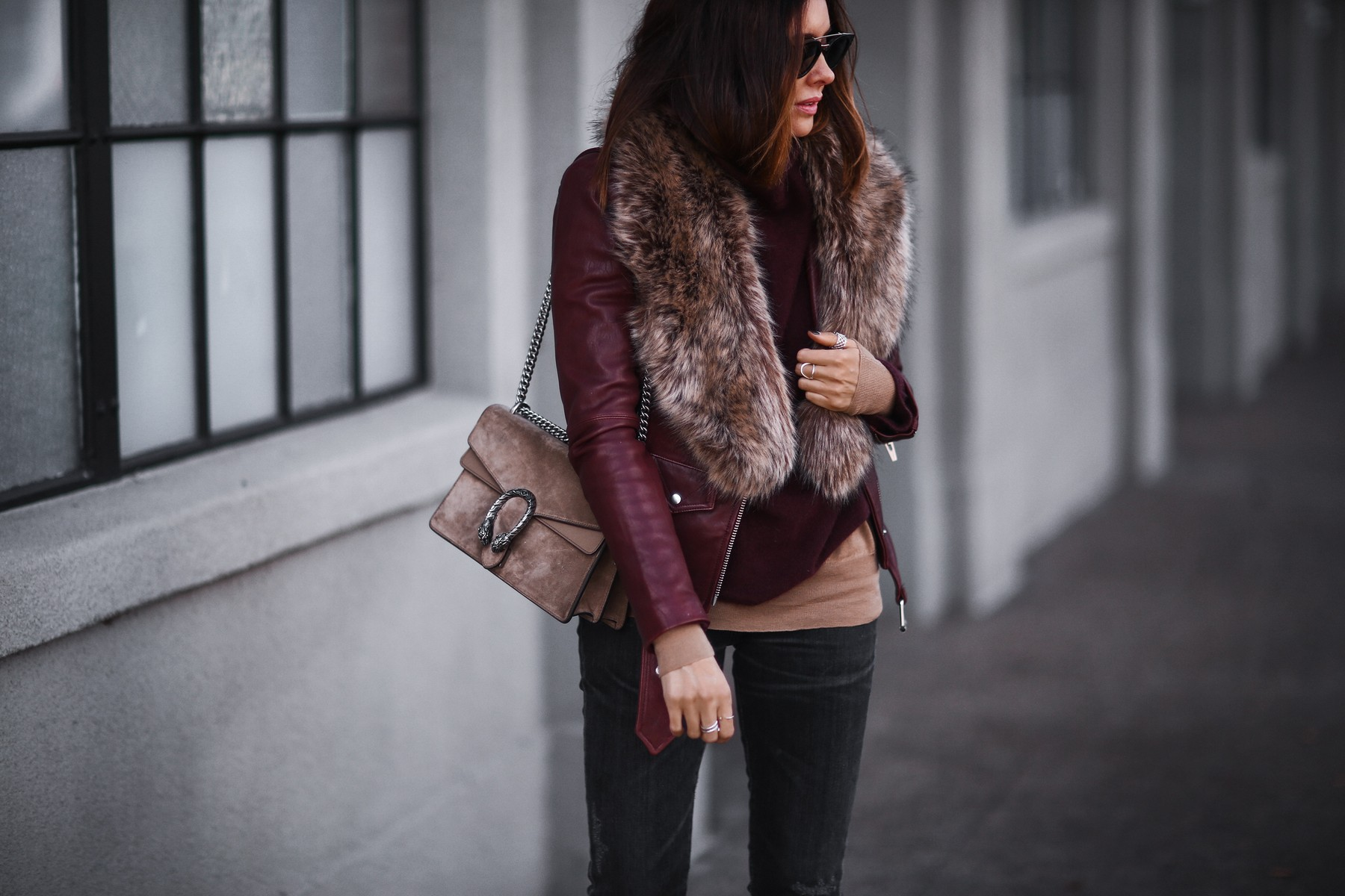 leather jacket, faux fur stole, layered sweaters, gucci bag