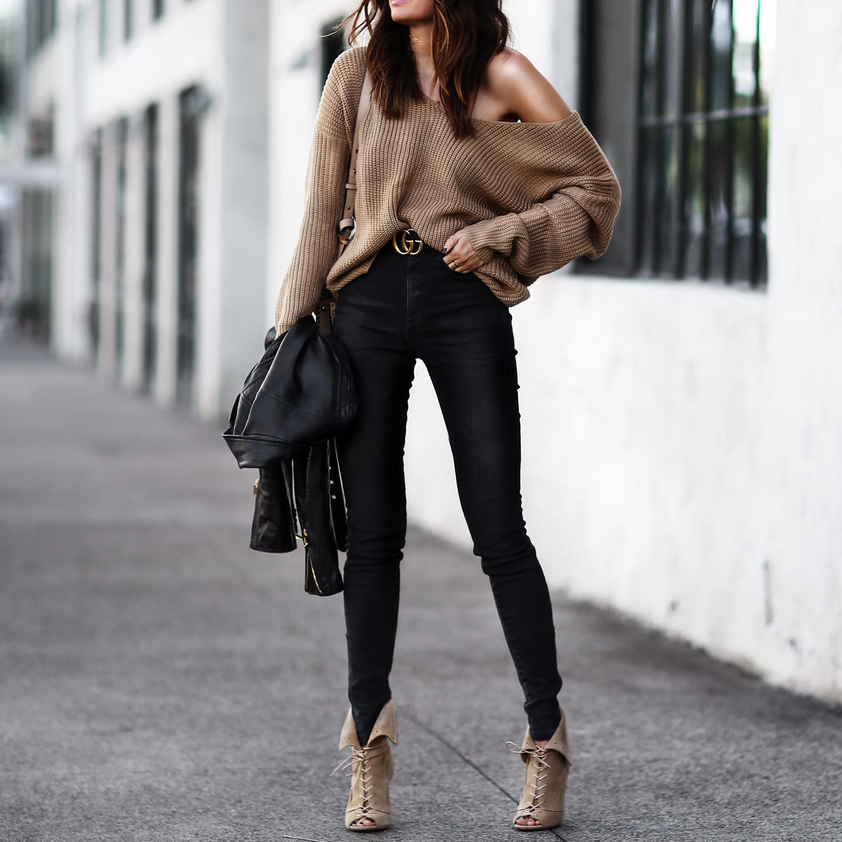 slouchy camel sweater, gucci belt, black high waisted skinny jeans, lace up heels