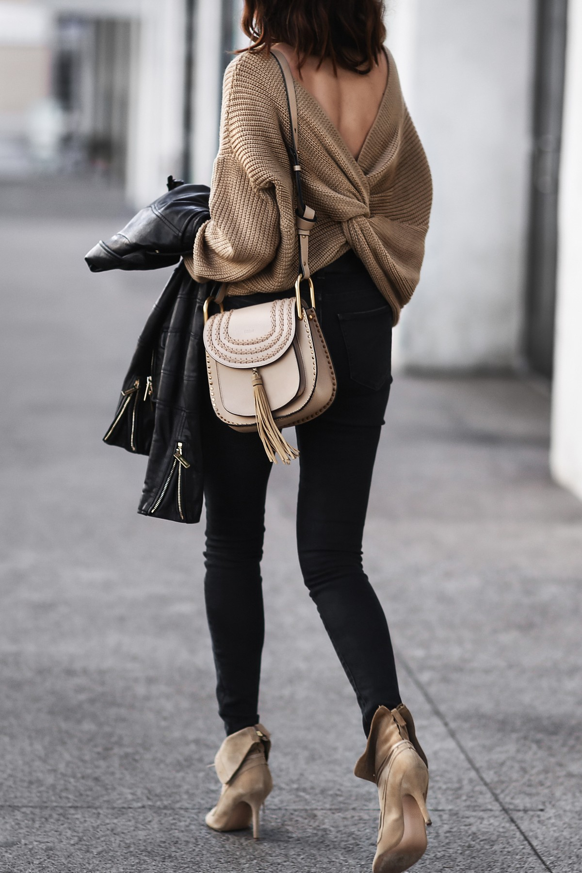 slouchy camel sweater with twisted back, black skinny jeans