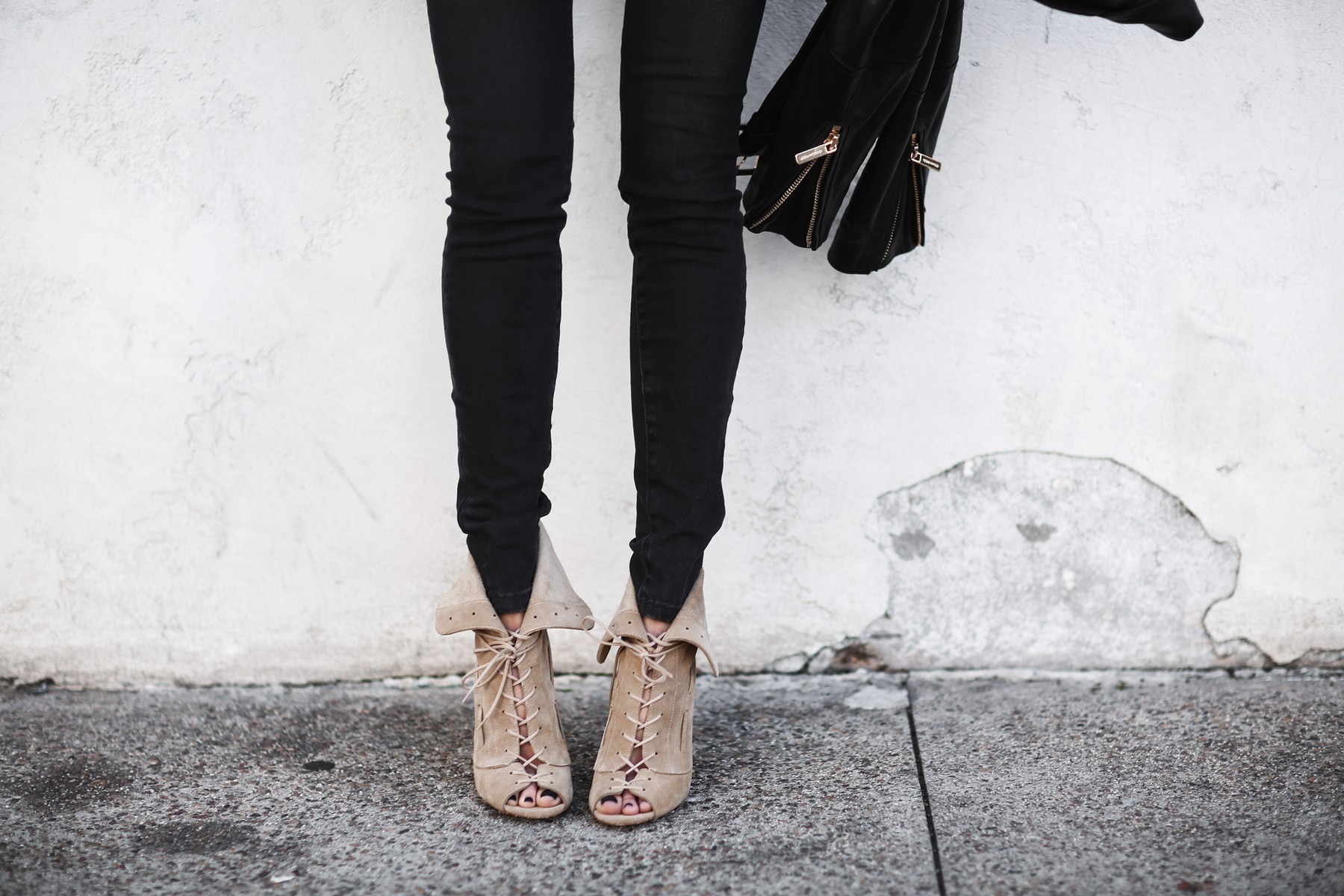 black skinny jeans, lace up camel heels