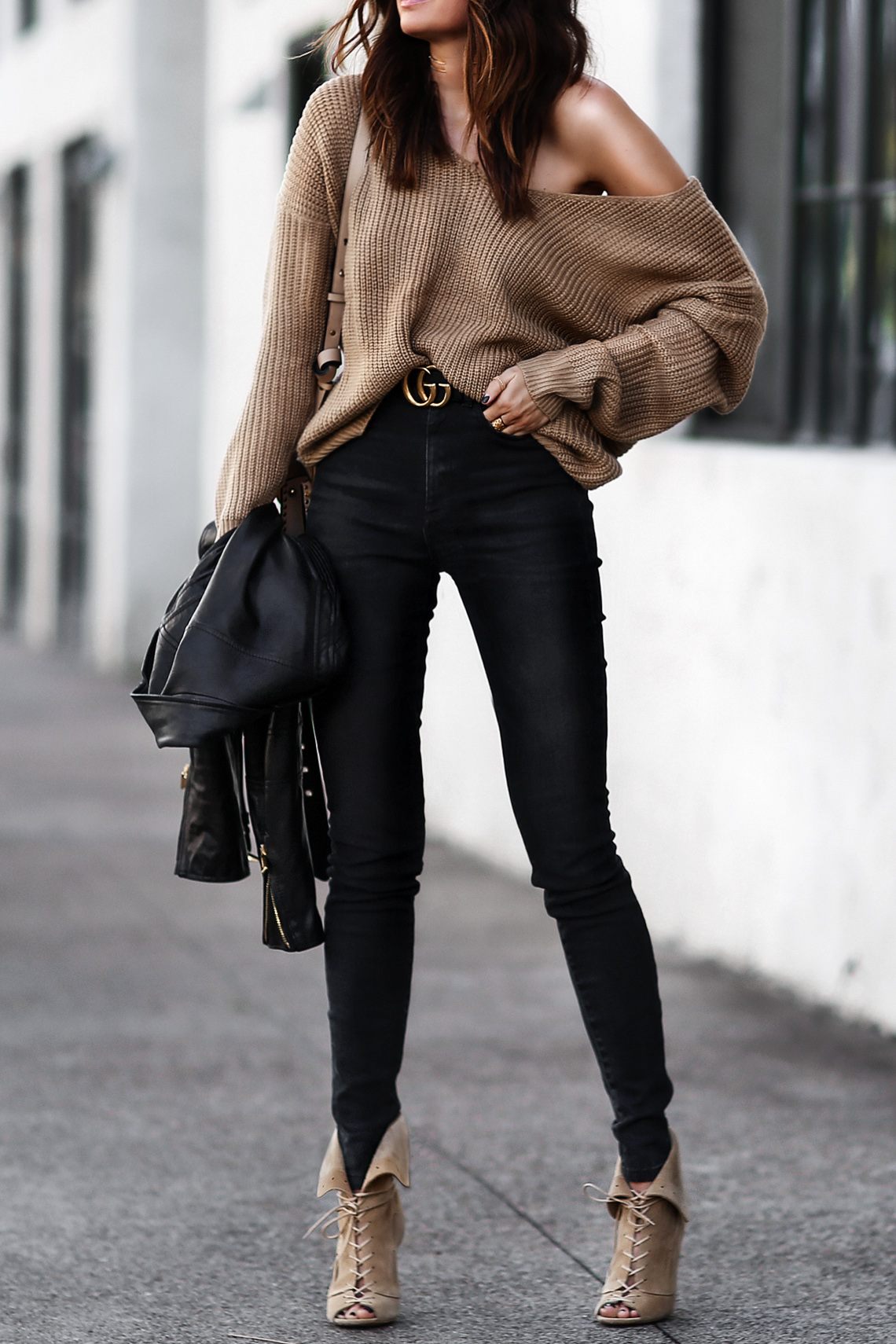 slouchy camel sweater, gucci belt, black skinny jeans, lace up heels