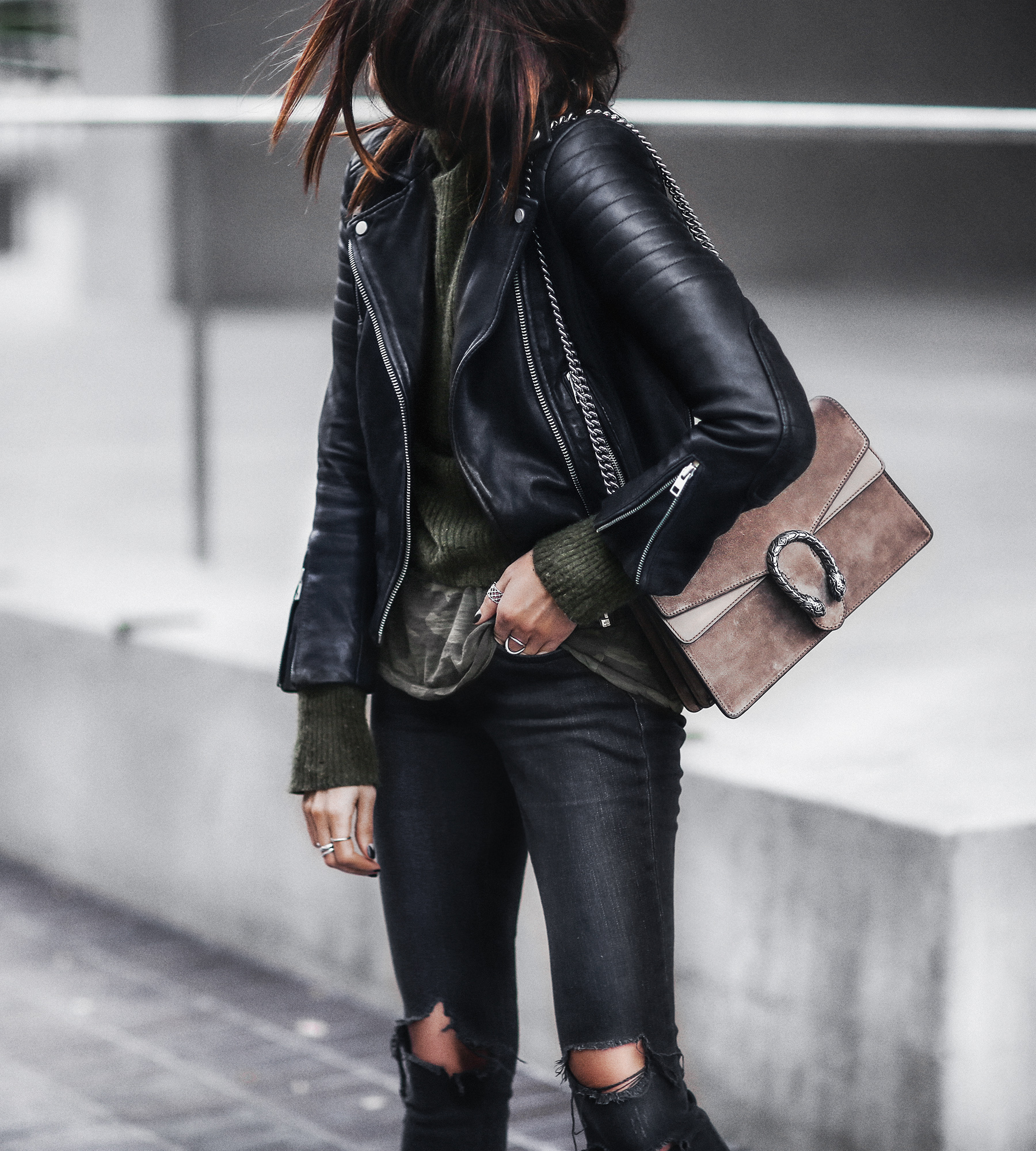 black leather jacket, camo tee, black ripped jeans, gucci bag