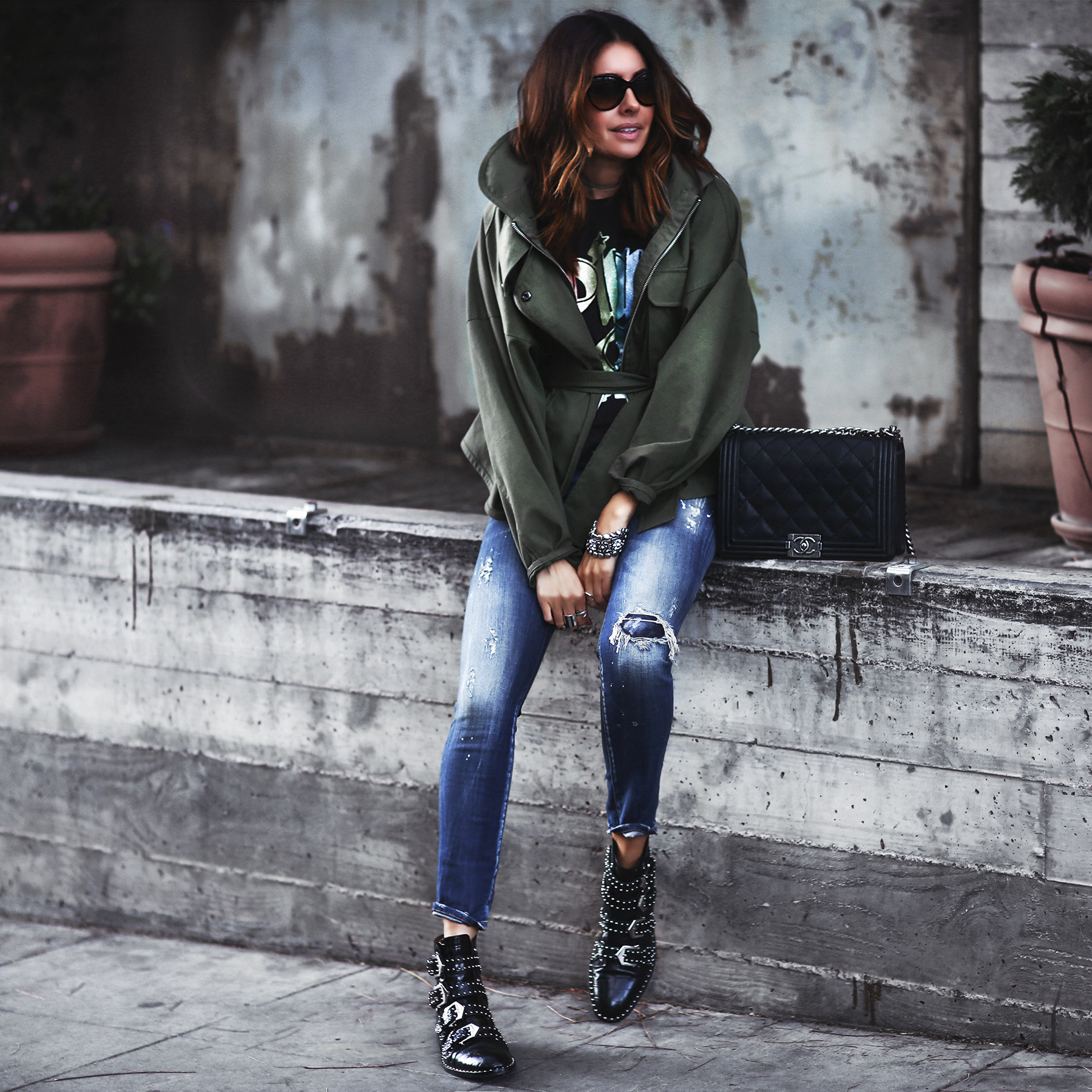 rock band tshirt, army green jacket, ripped skinny jeans, givenchy booties