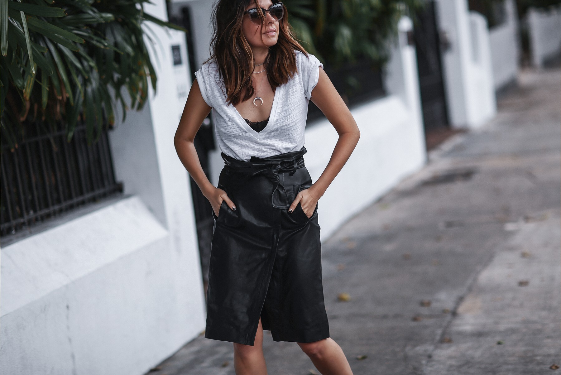black knee length leather skirt and white tshirt