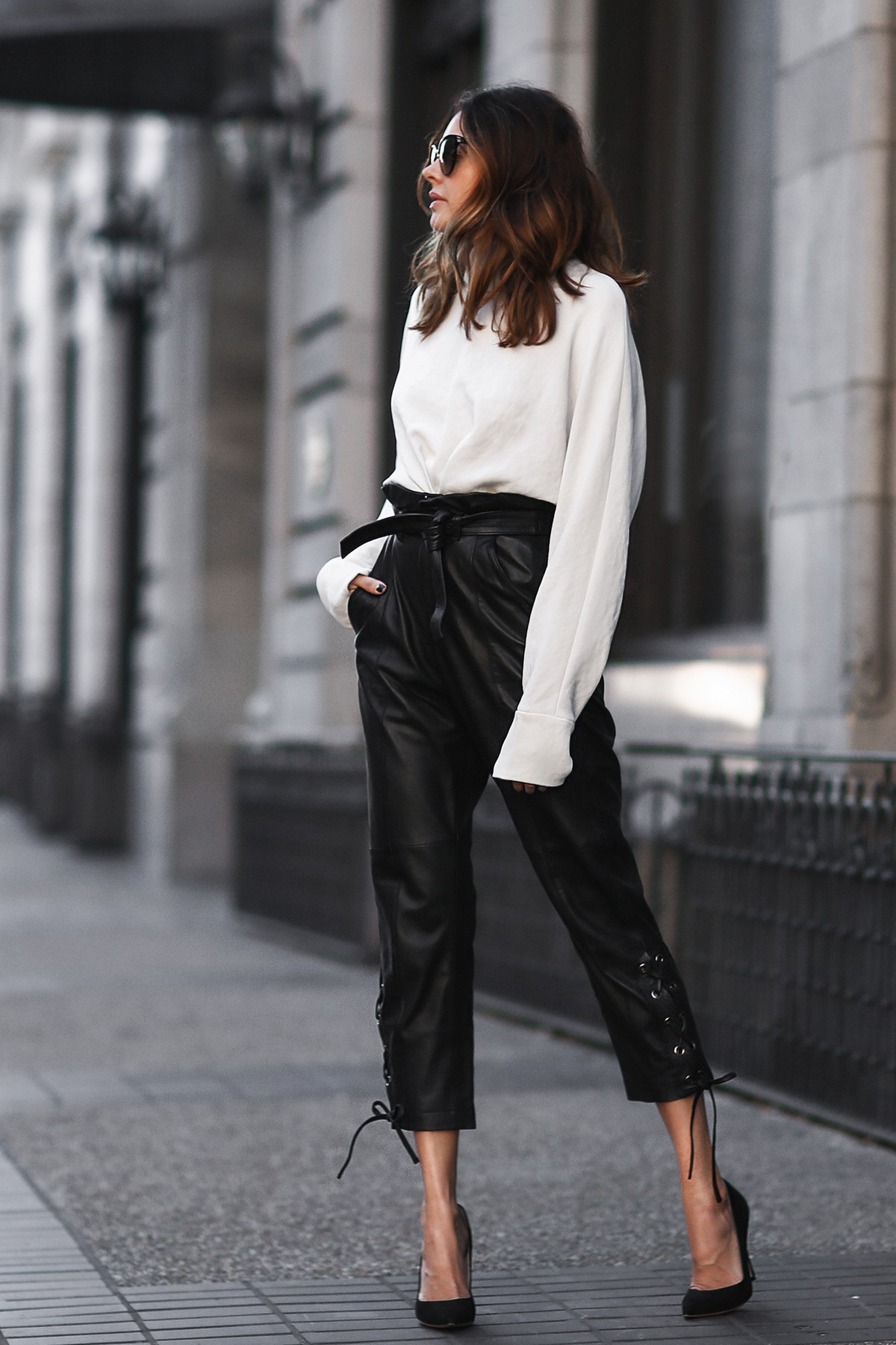 black leather pants, white blouse, black pumps