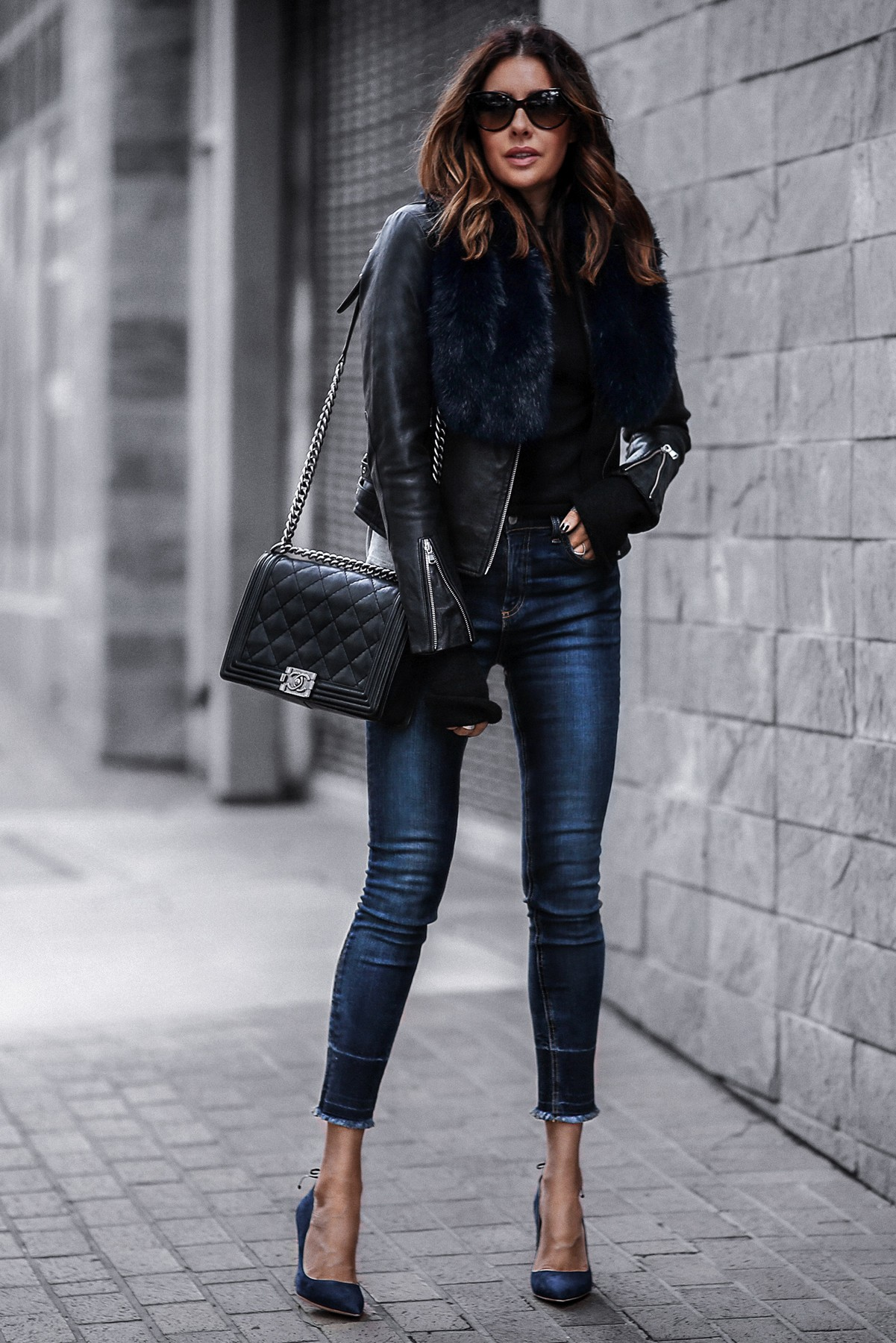 black leather jacket, raw hem skinny jeans, faux fur stole, chanel bag, blue suede pumps