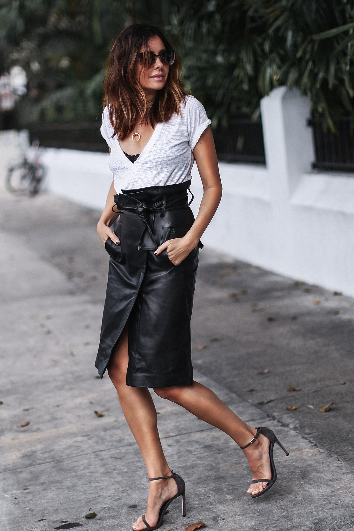 knee length leather skirt and white tshirt