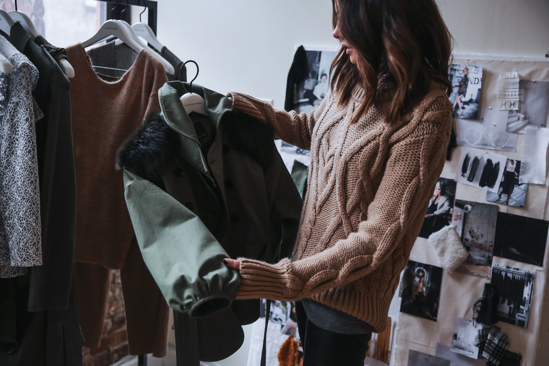 camel cable knit sweater and army green jacket with shearling
