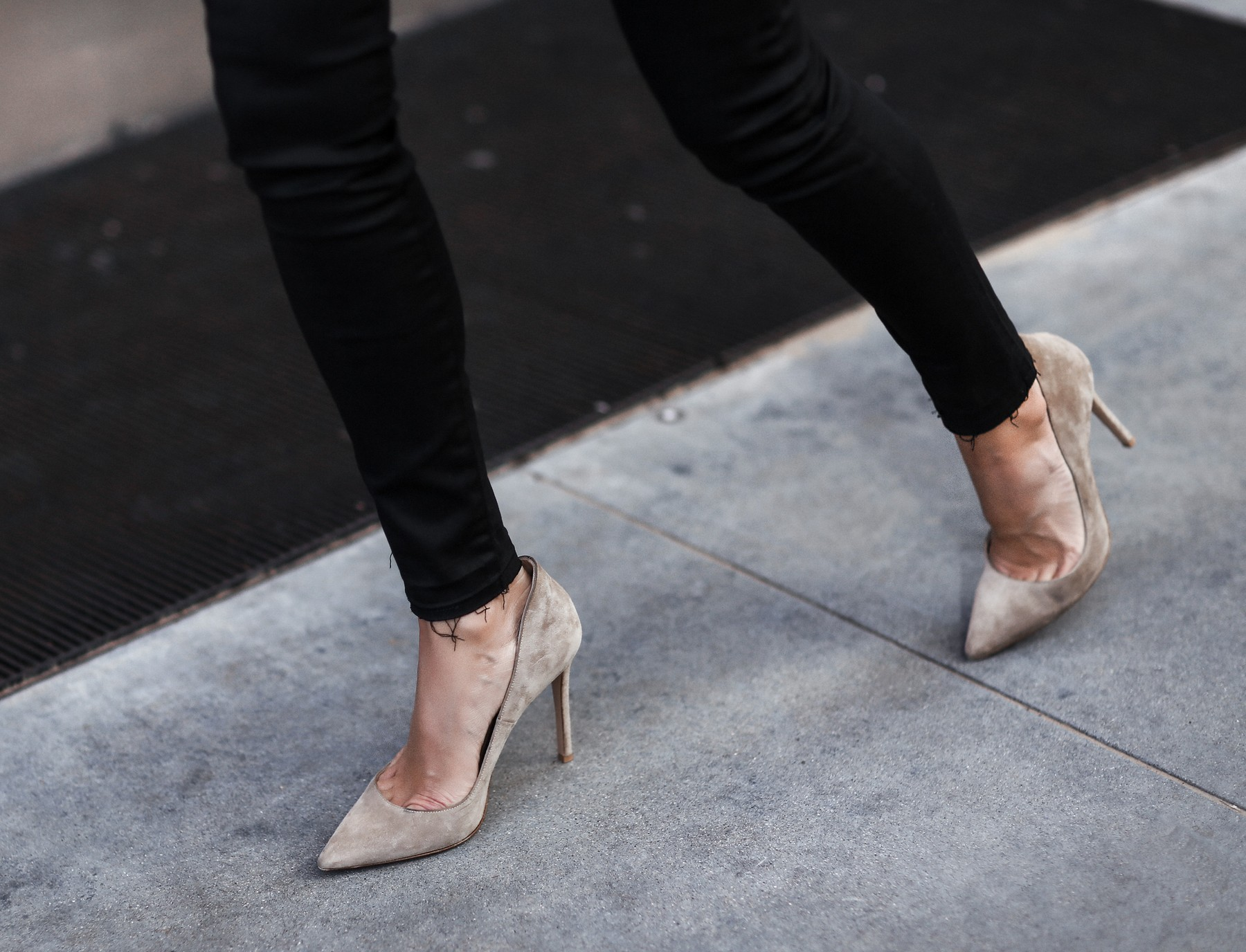 matte black jeans with frayed hem, nude suede pumps