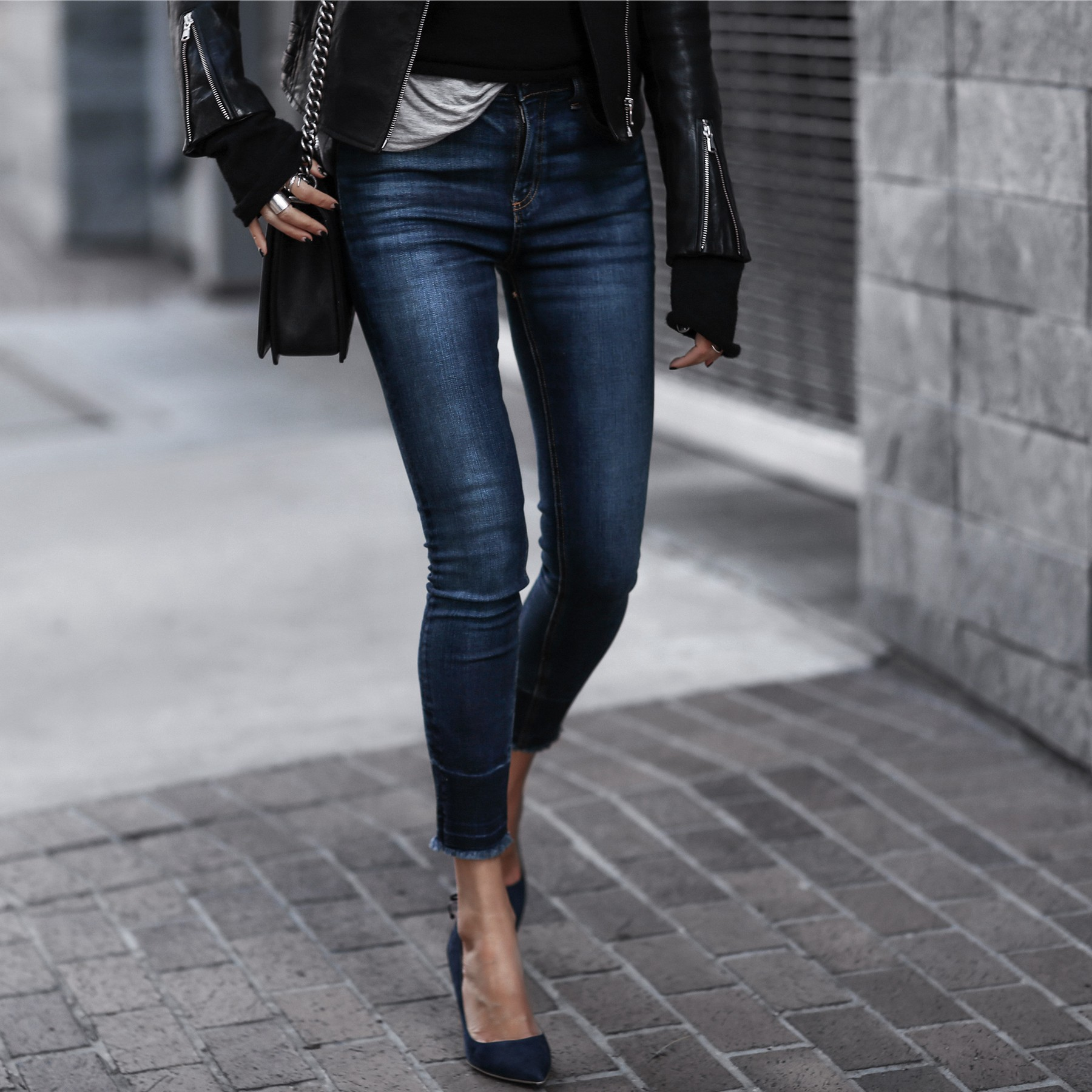 black leather jacket, raw hem skinny jeans, chanel bag, blue suede pumps