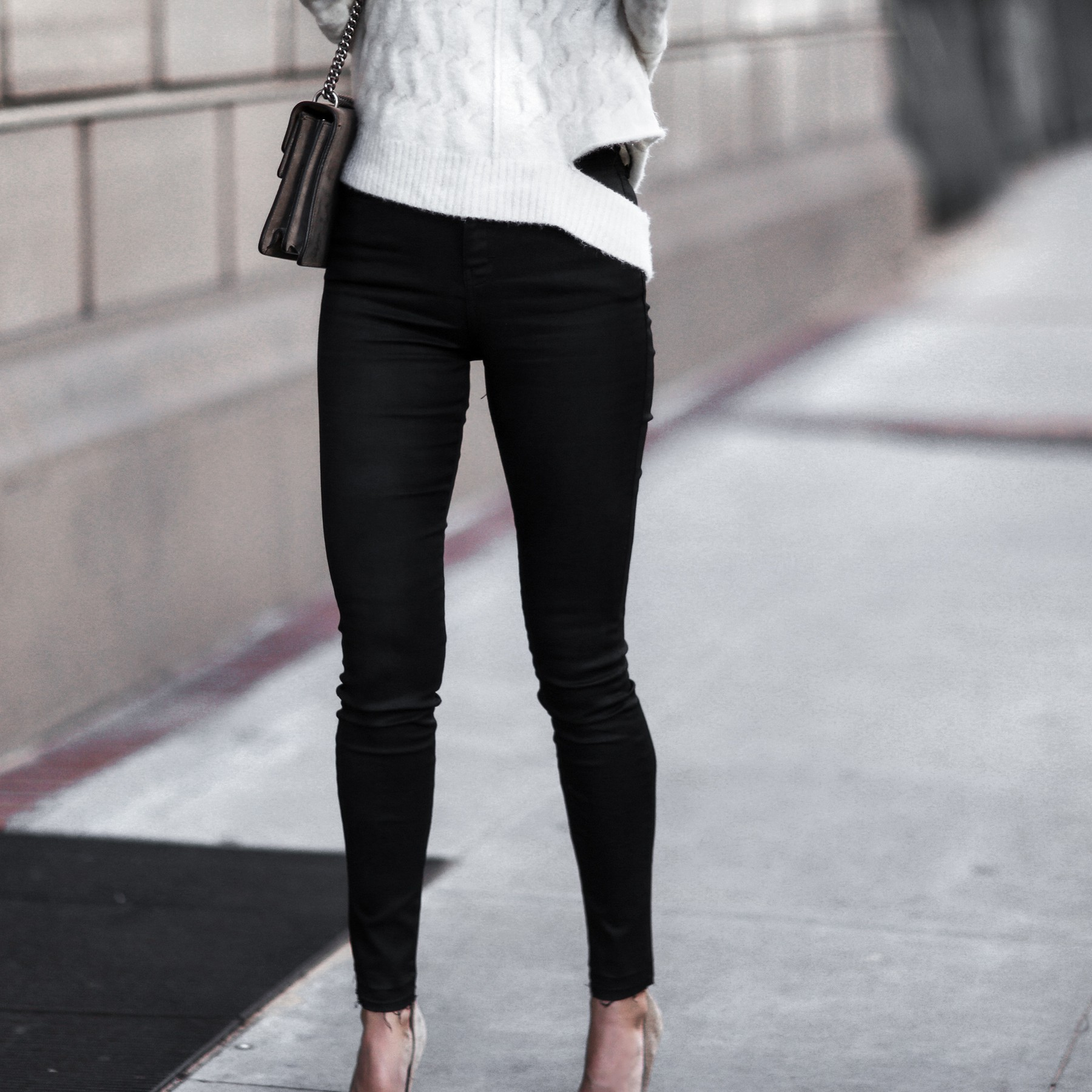 matte black jeans with frayed hem, white knit sweater with cut outs, nude suede pumps, gucci bag