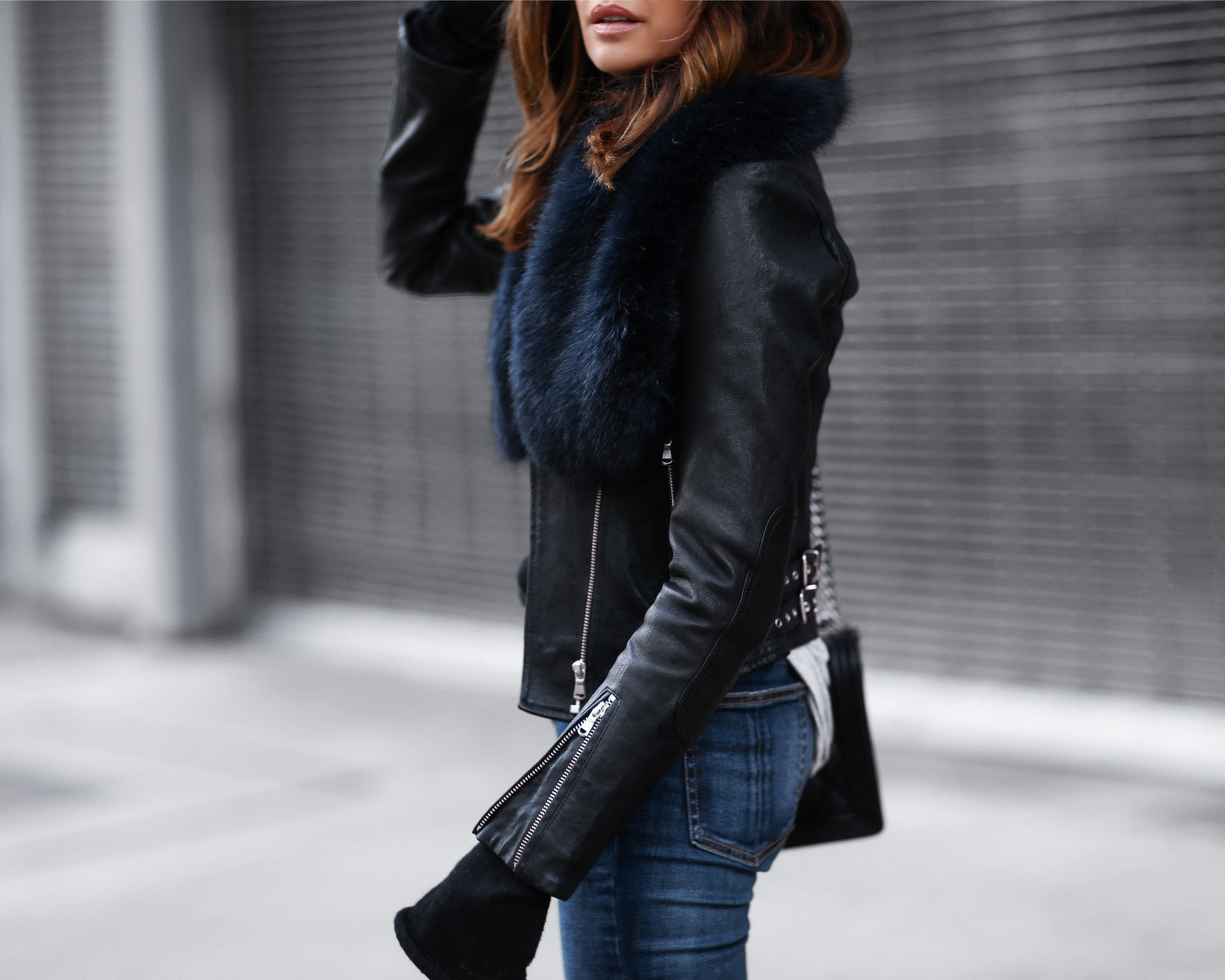 black leather jacket, raw hem skinny jeans, faux fur stole, chanel bag