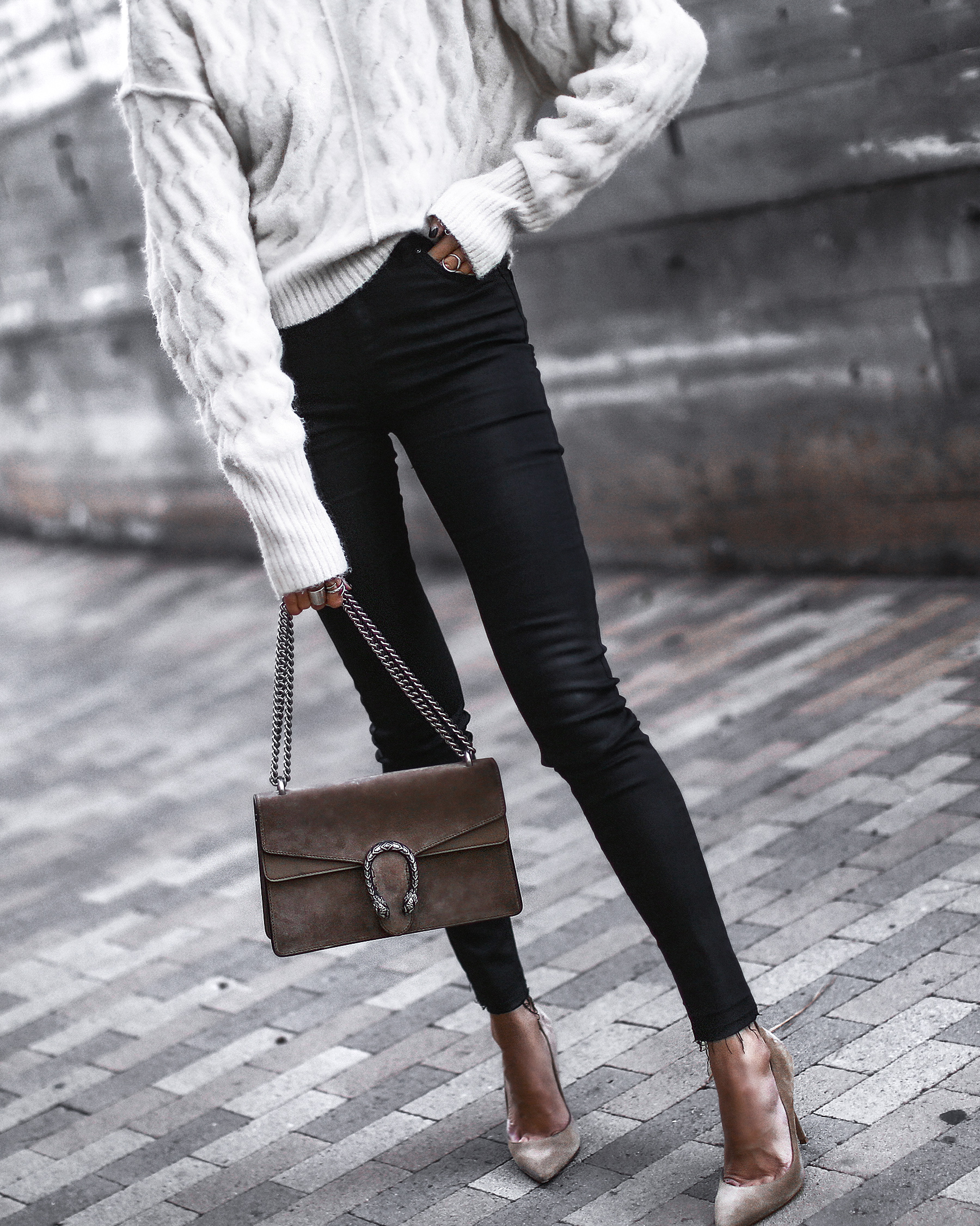 white knit sweater, black coated skinny jeans, nude suede pumps, gucci bag
