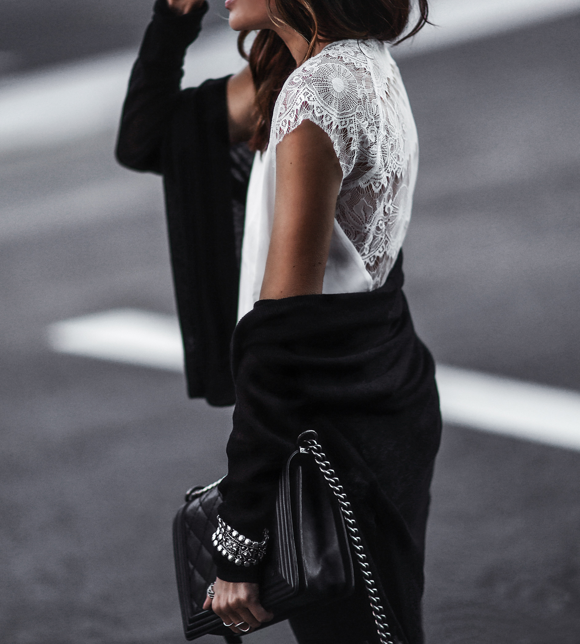white lace top, black oversized sweater