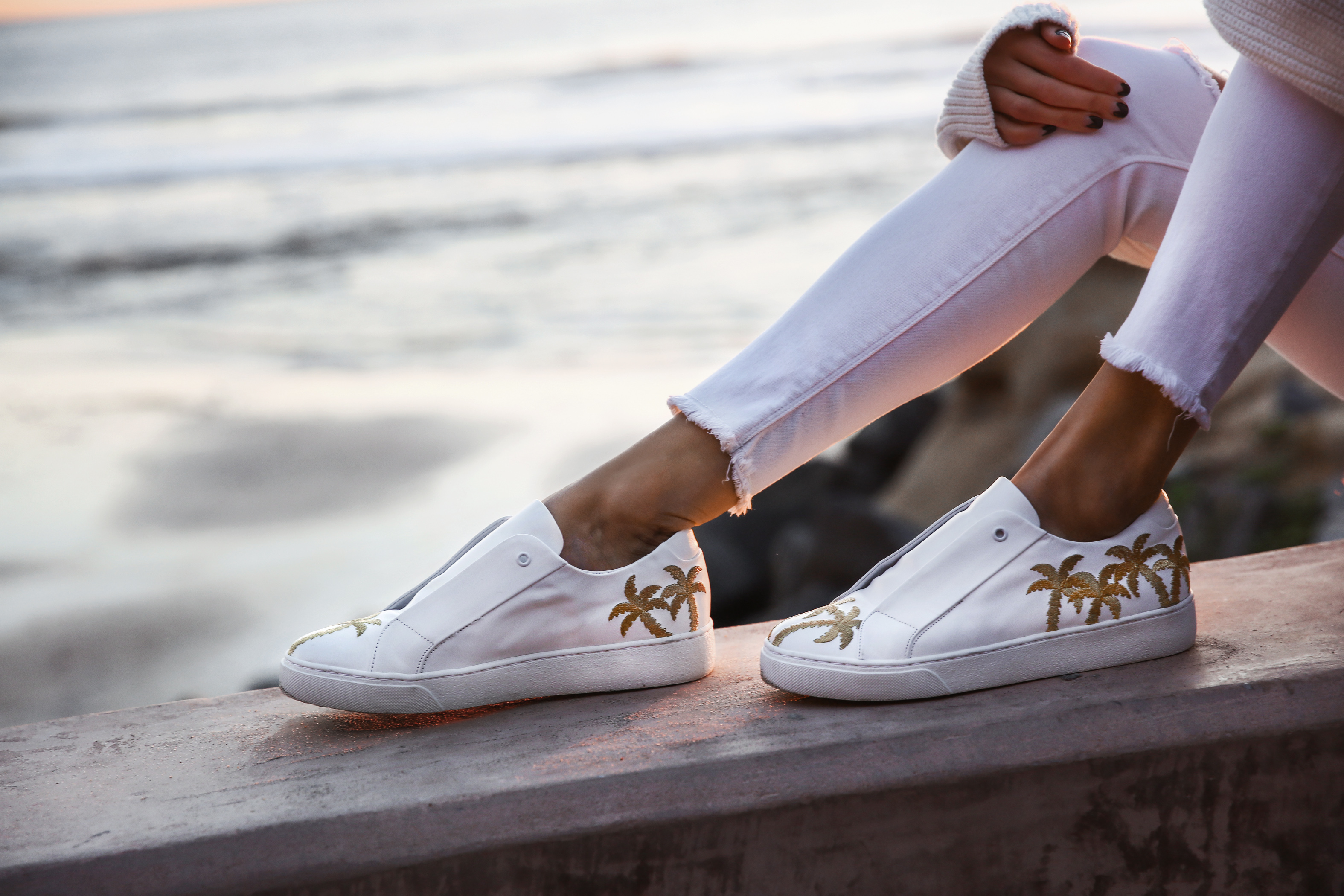 white sneakers with palm trees, white skinny jeans with raw hem