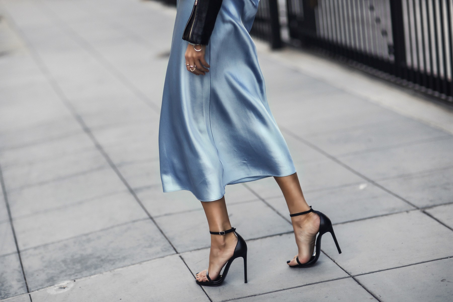 light blue slip dress, black leather jacket, black ankle strap sandals