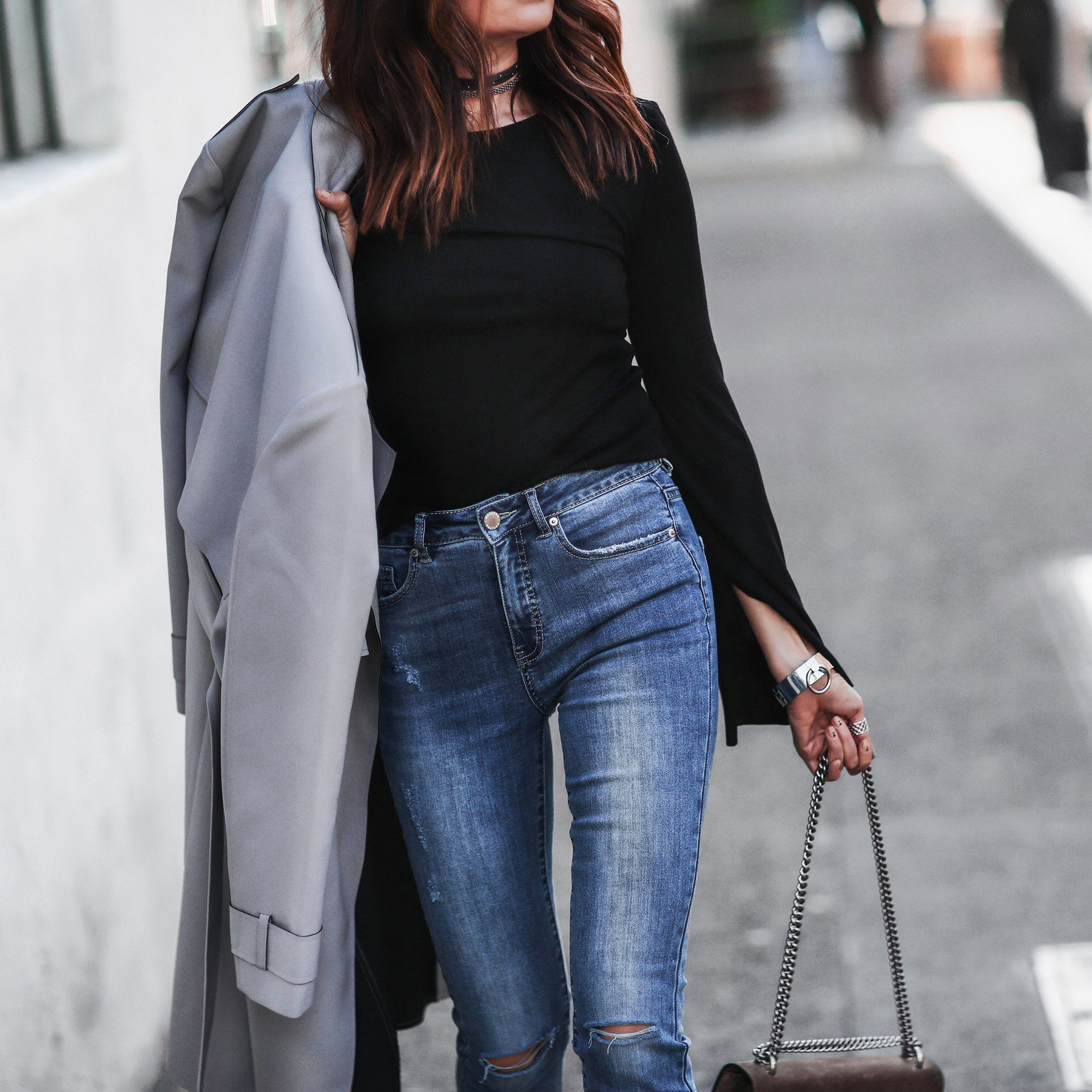 gray trench coat, high waisted skinny jeans, bell sleeve top, layered chokers