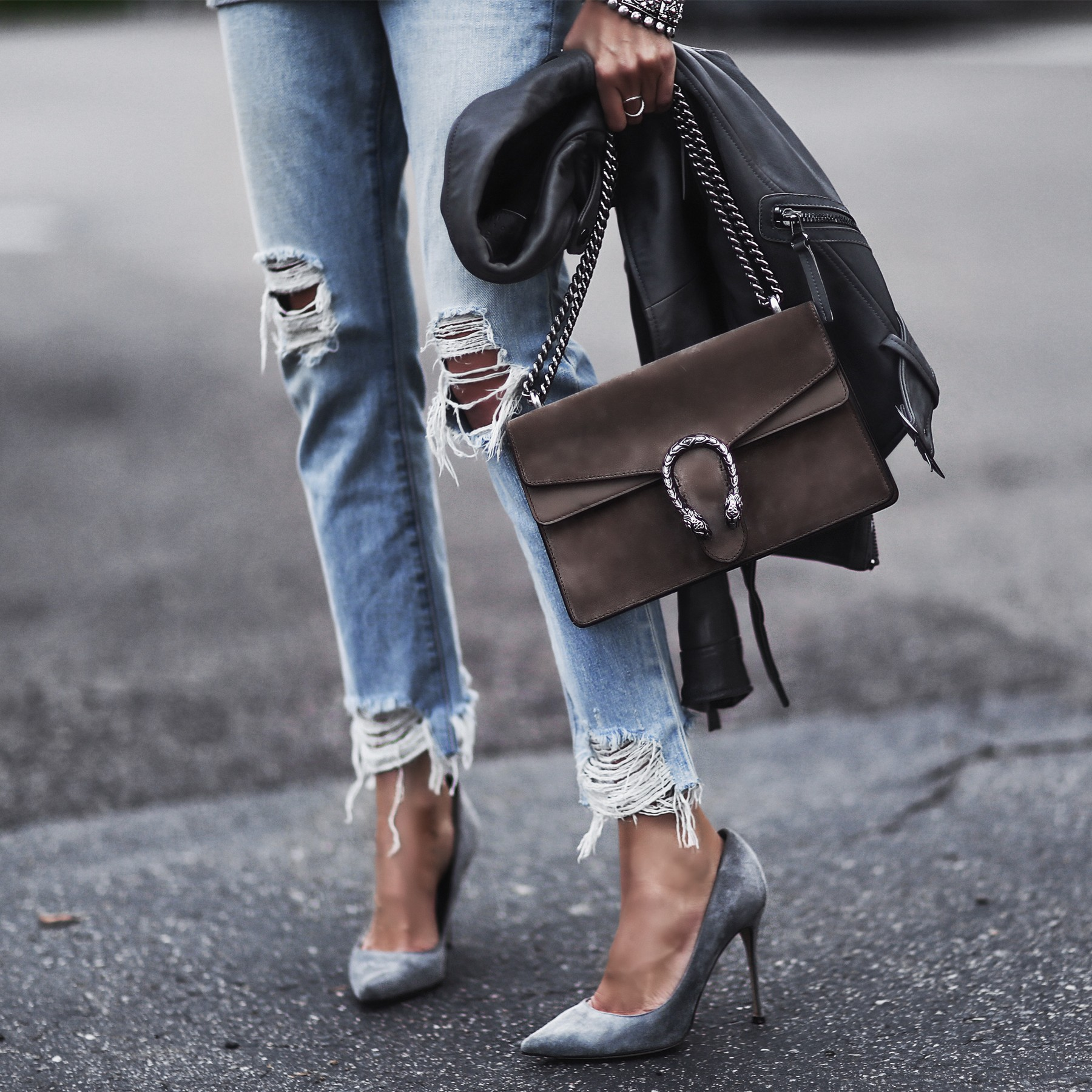 moto jacket, ripped boyfriend jeans, gray suede pumps, gucci bag