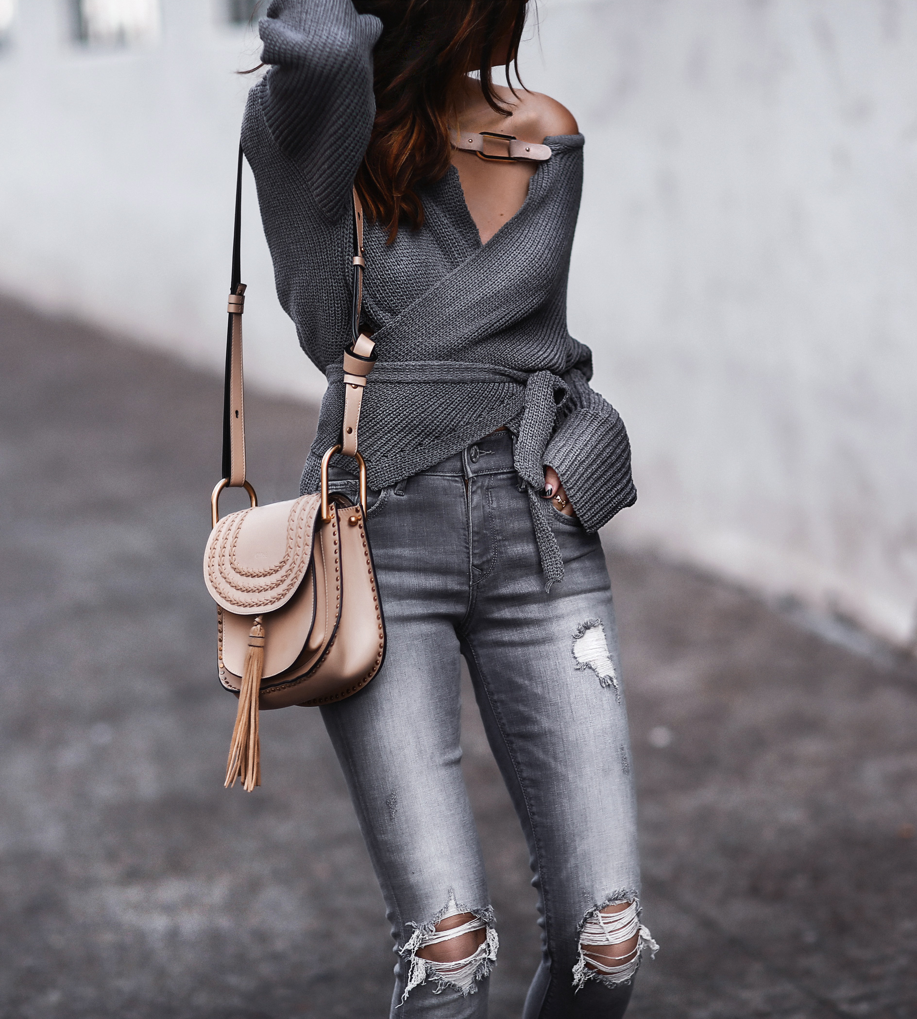 grey wrap sweater, grey ripped skinny jeans, chloe bag