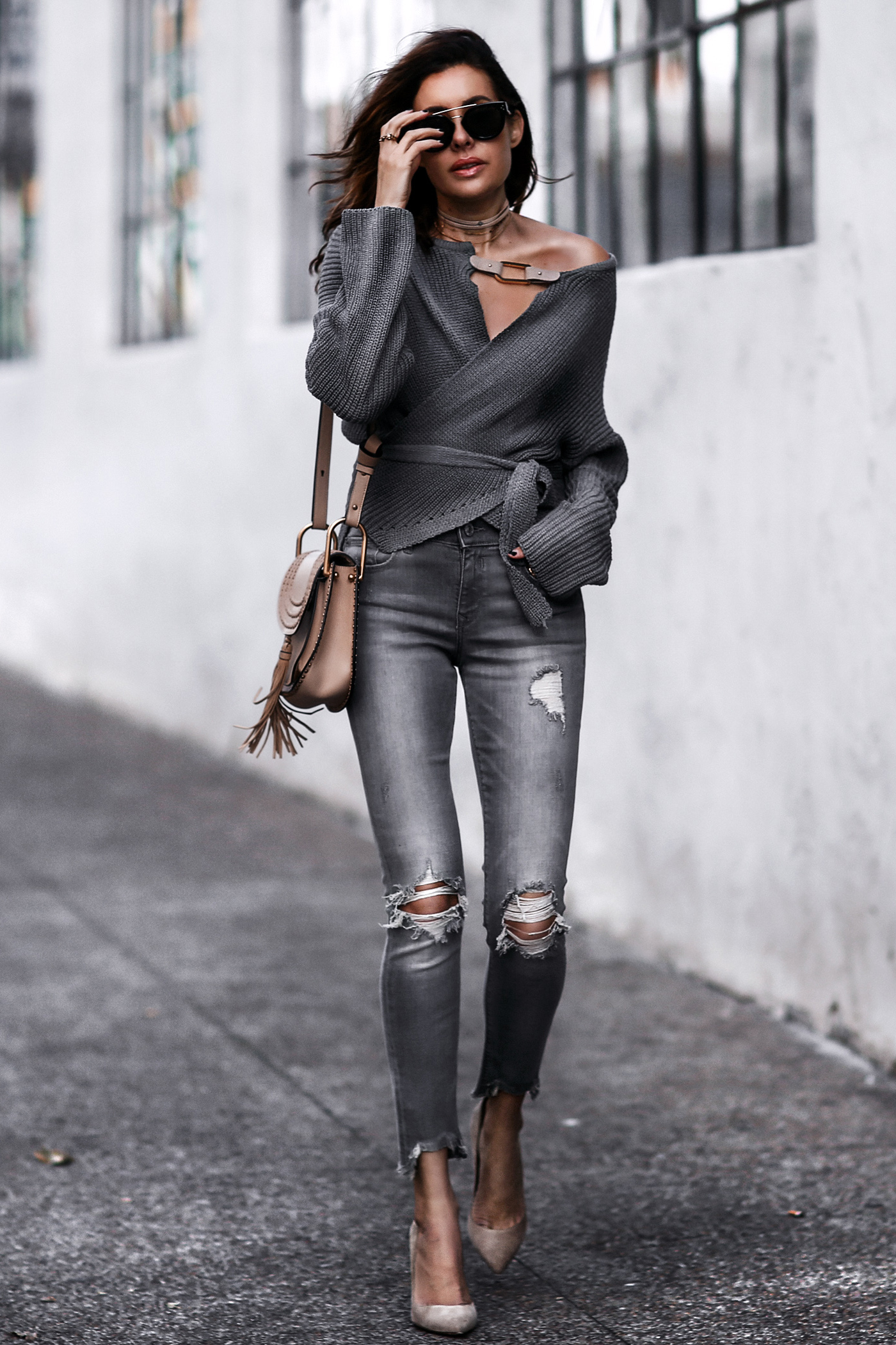 grey wrap sweater, grey ripped skinny jeans, nude suede pumps